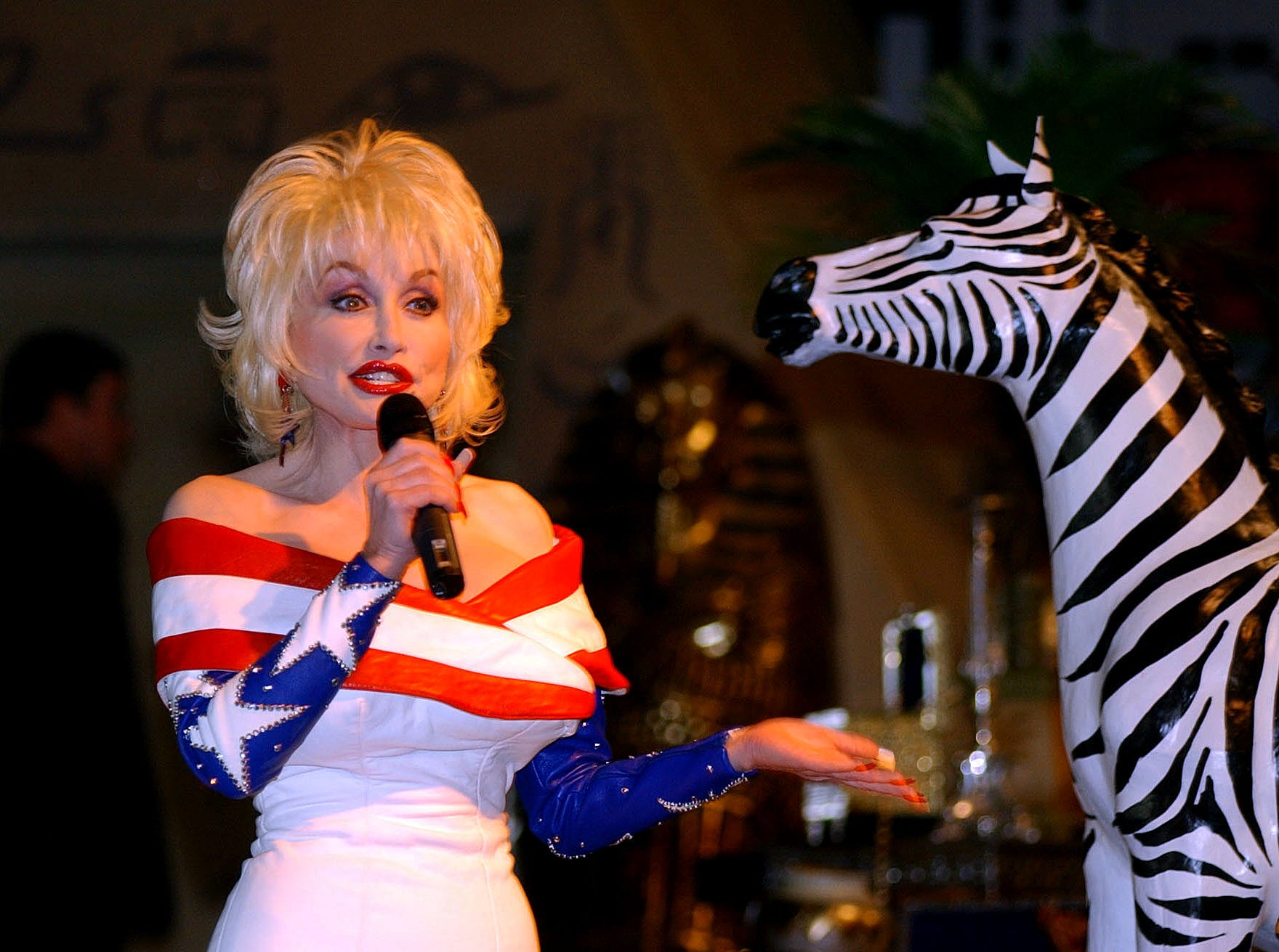 Dolly Parton talks to reporters during media day at Dollywood Friday.  Dolly was announcing the opening of her Festival of Nations which opens Saturday, April 5, 2003.