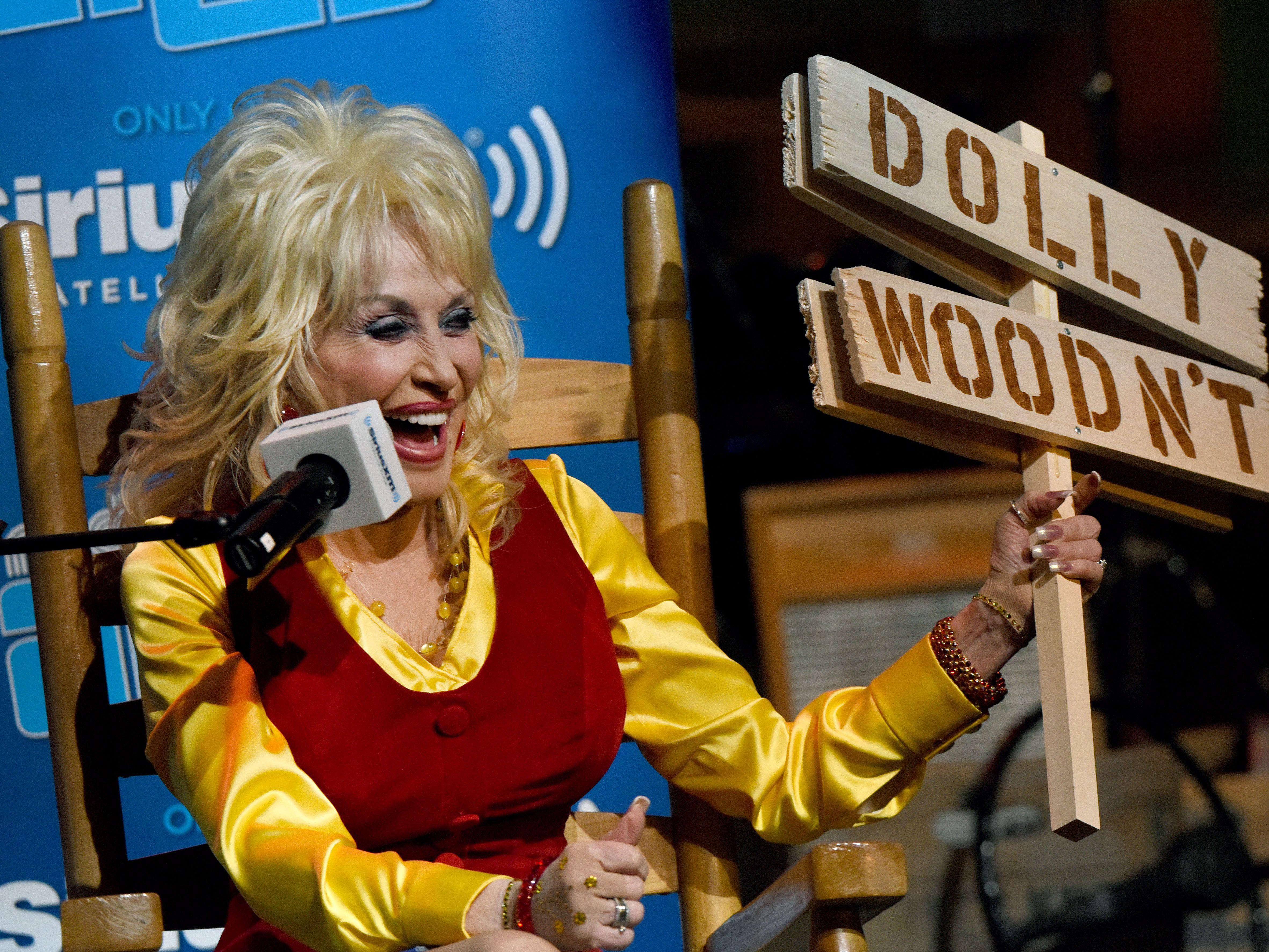 "Dolly Parton takes part in a game of ""Dolly Wood or Dolly Wouldn't"" with SiriusXM satellite radio host Andy Cohen Friday, May 6, 2016, at Dollywood. SiriusXM radio subscribers submitted questions for Parton with the winners invited to pose their questions during the show."