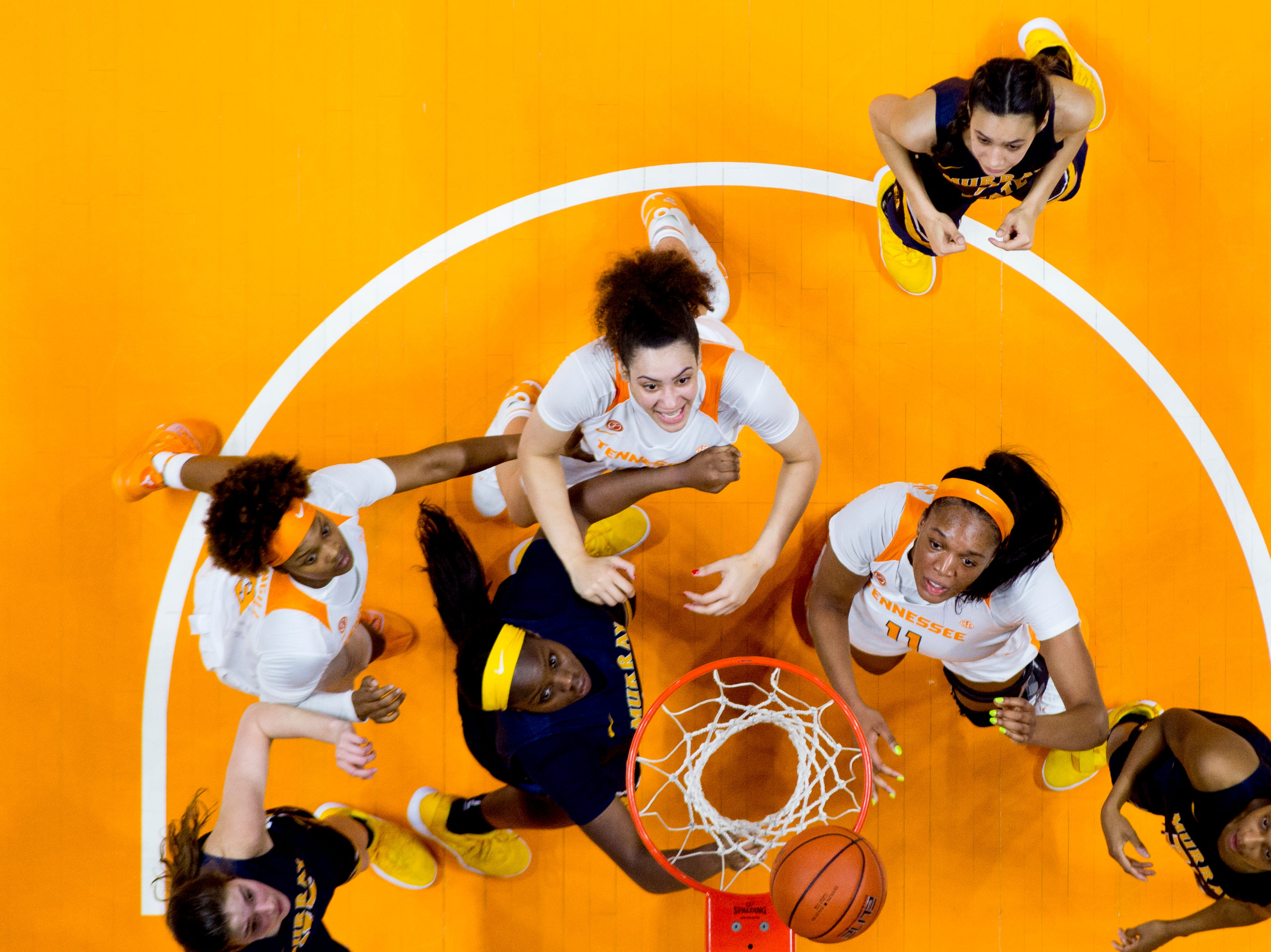 Players eye the ball above the rim during a game between the Tennessee Lady Vols and Murray State at Thompson-Boling Arena in Knoxville, Tennessee on Friday, December 28, 2018.