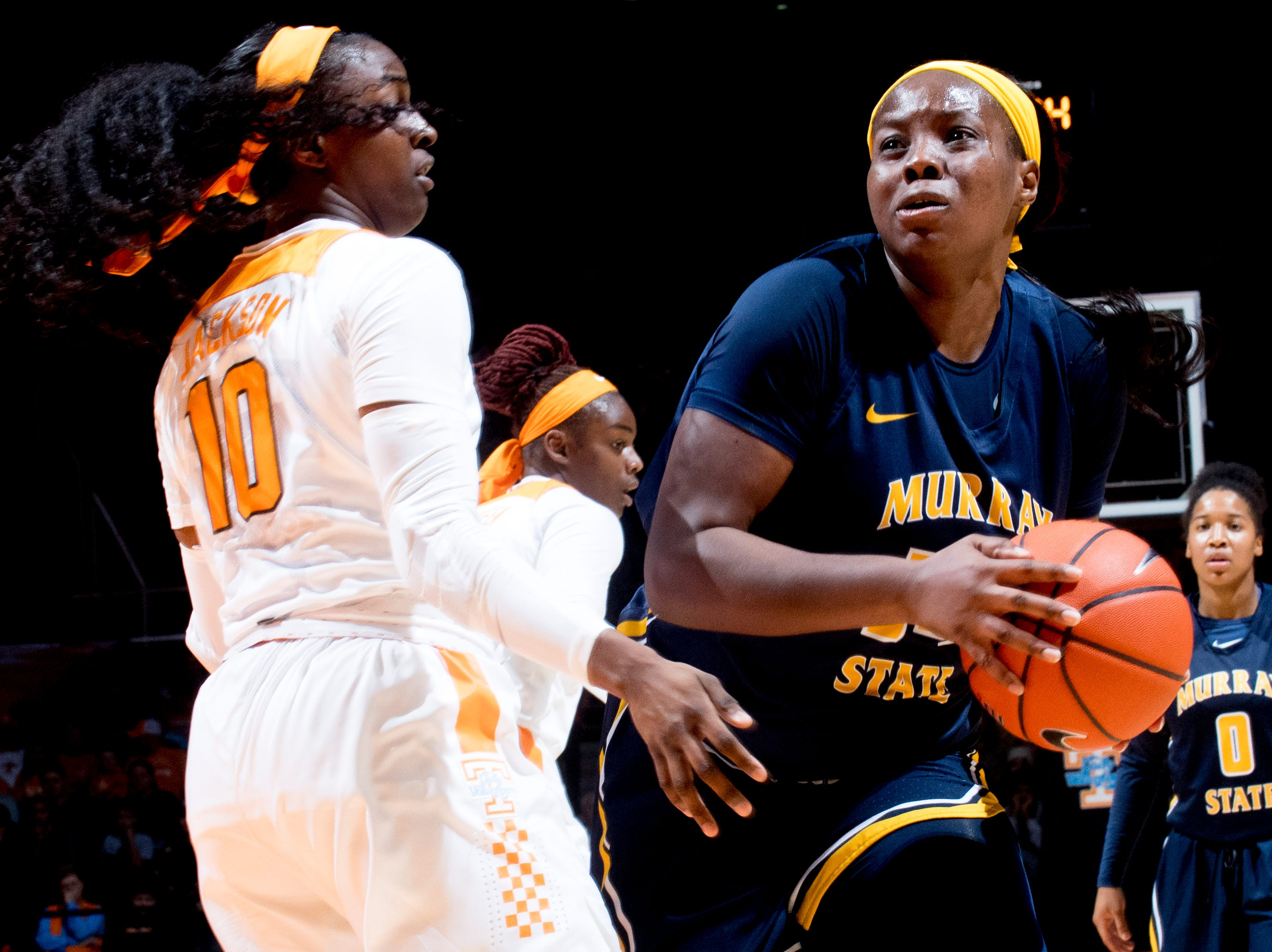 Murray State forward Cekeya Mack (20) dribbles past Tennessee guard/forward Meme Jackson (10) during a game between the Tennessee Lady Vols and Murray State at Thompson-Boling Arena in Knoxville, Tennessee on Friday, December 28, 2018.