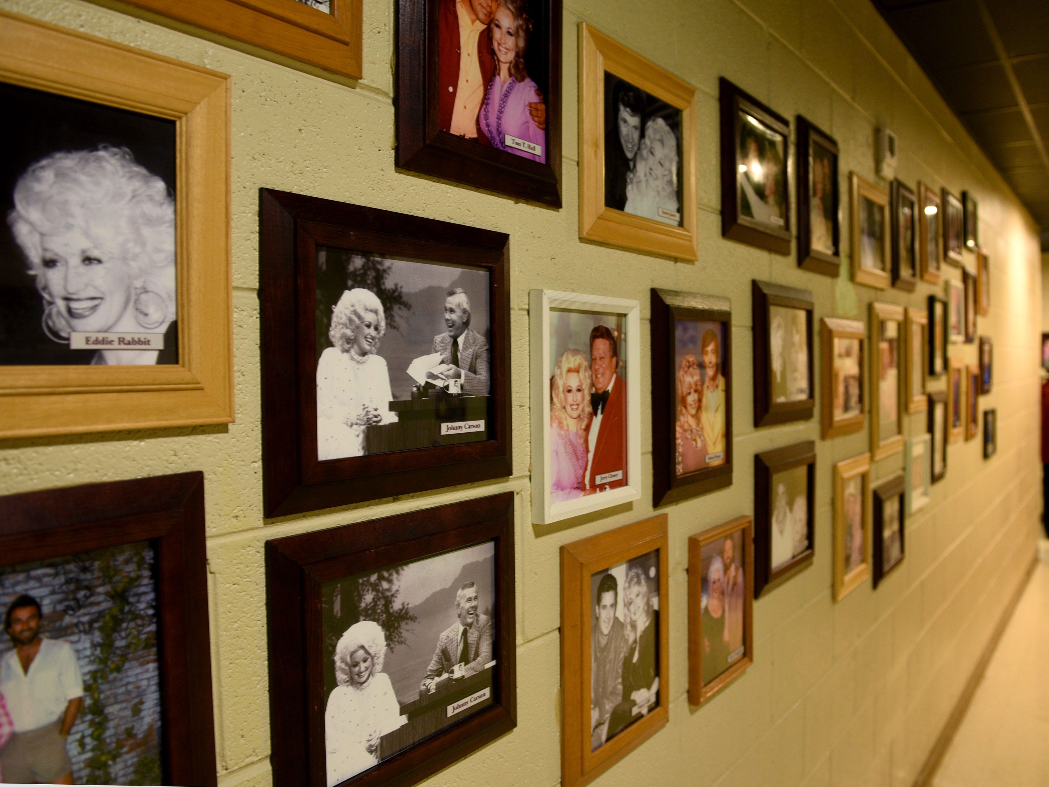 One of the many hallways with photos of Dolly at Dollywood during their 30th anniversary Wednesday, Apr. 22, 2015.