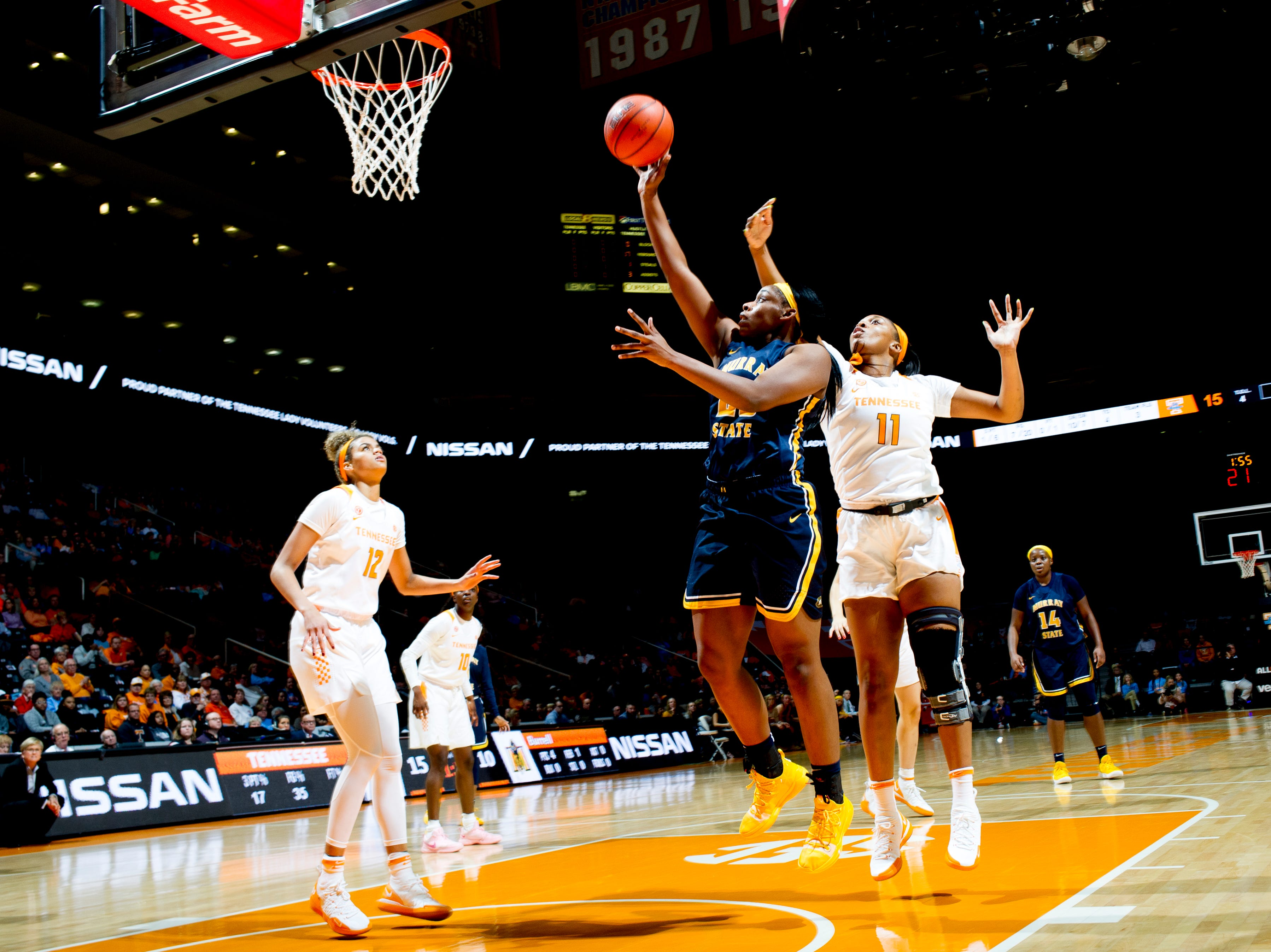 Murray State forward Cekeya Mack (20) shoots a layup as Tennessee center Kasiyahna Kushkituah (11) defends during a game between the Tennessee Lady Vols and Murray State at Thompson-Boling Arena in Knoxville, Tennessee on Friday, December 28, 2018.