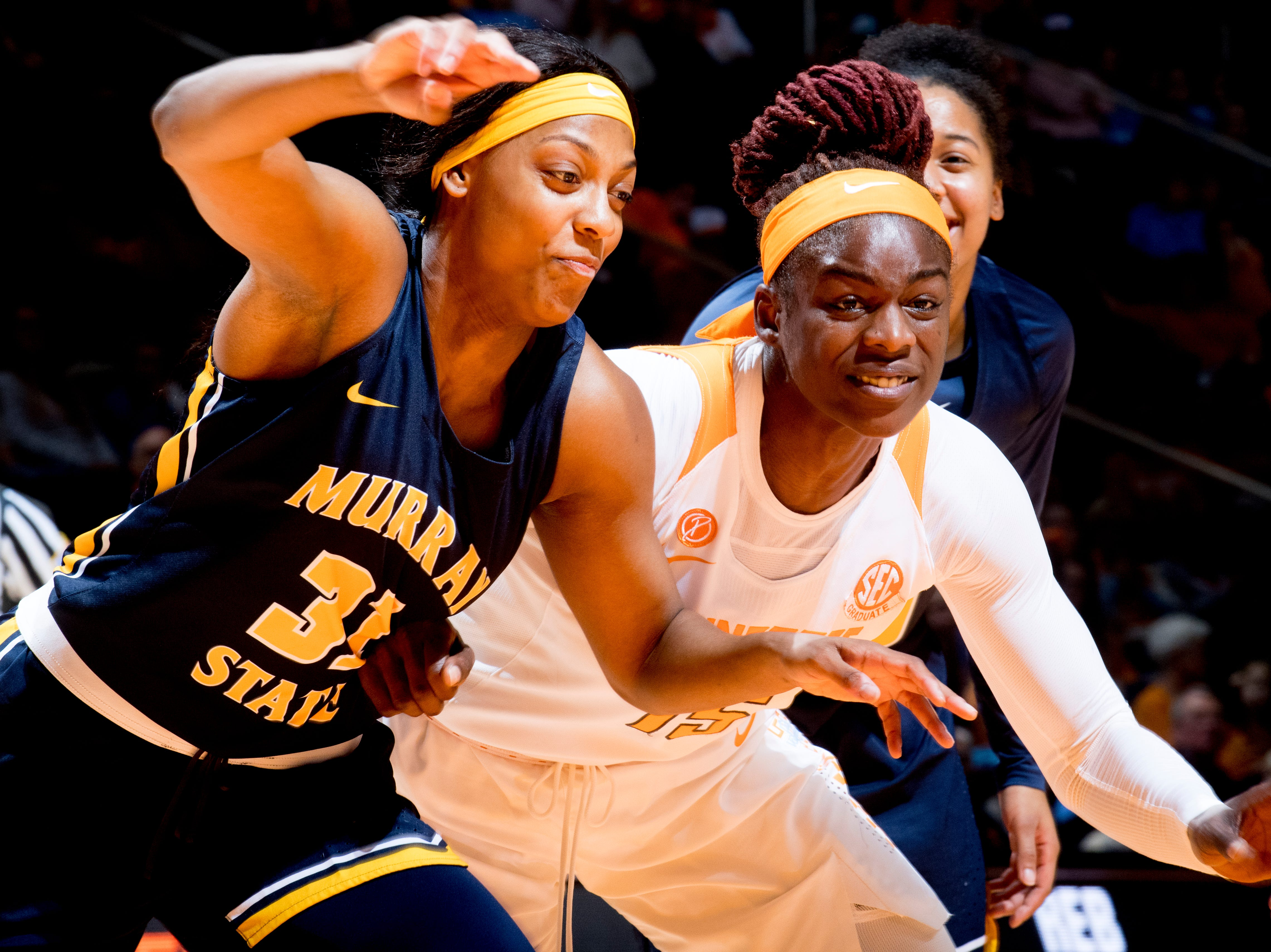 Tennessee forward Cheridene Green (15) and Murray State forward Brianna Crane (31) go for the rebound ball during a game between the Tennessee Lady Vols and Murray State at Thompson-Boling Arena in Knoxville, Tennessee on Friday, December 28, 2018.