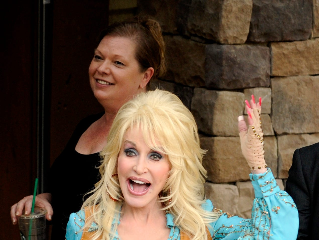 Dolly Parton performs on opening day of the Dollywood season Friday, March 23, 2012 in Pigeon Forge.