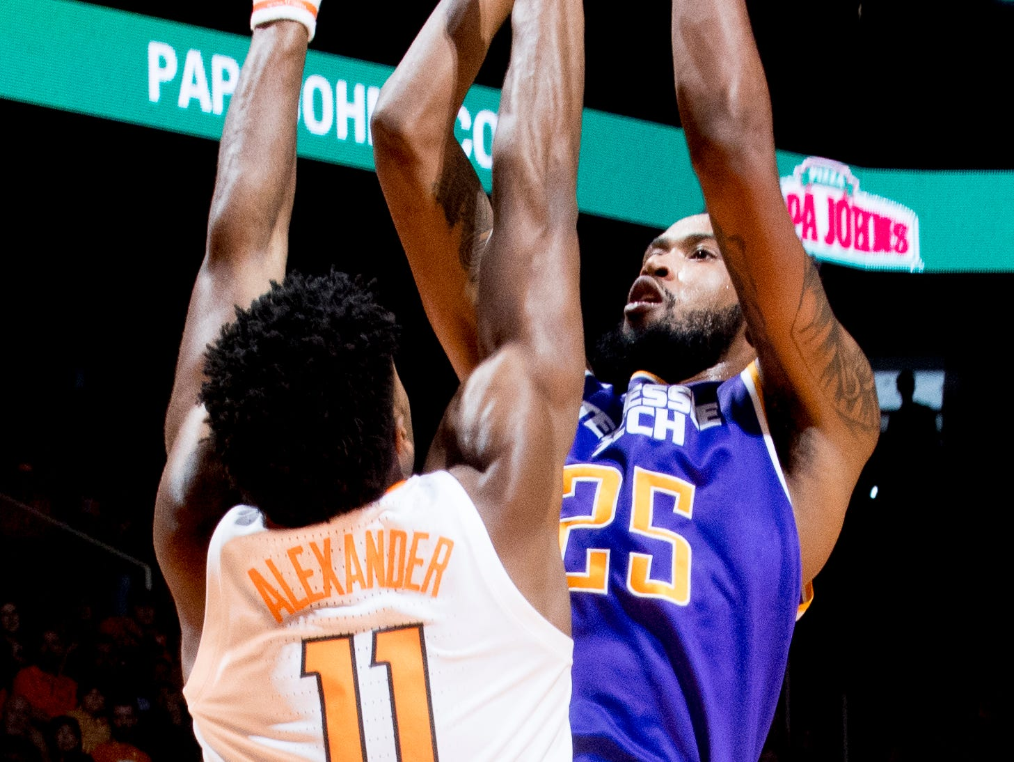 Tennessee Tech forward Malik Martin (25) shoots past Tennessee forward Kyle Alexander (11)  during a game between Tennessee and Tennessee Tech at Thompson-Boling Arena in Knoxville, Tennessee on Saturday, December 29, 2018.