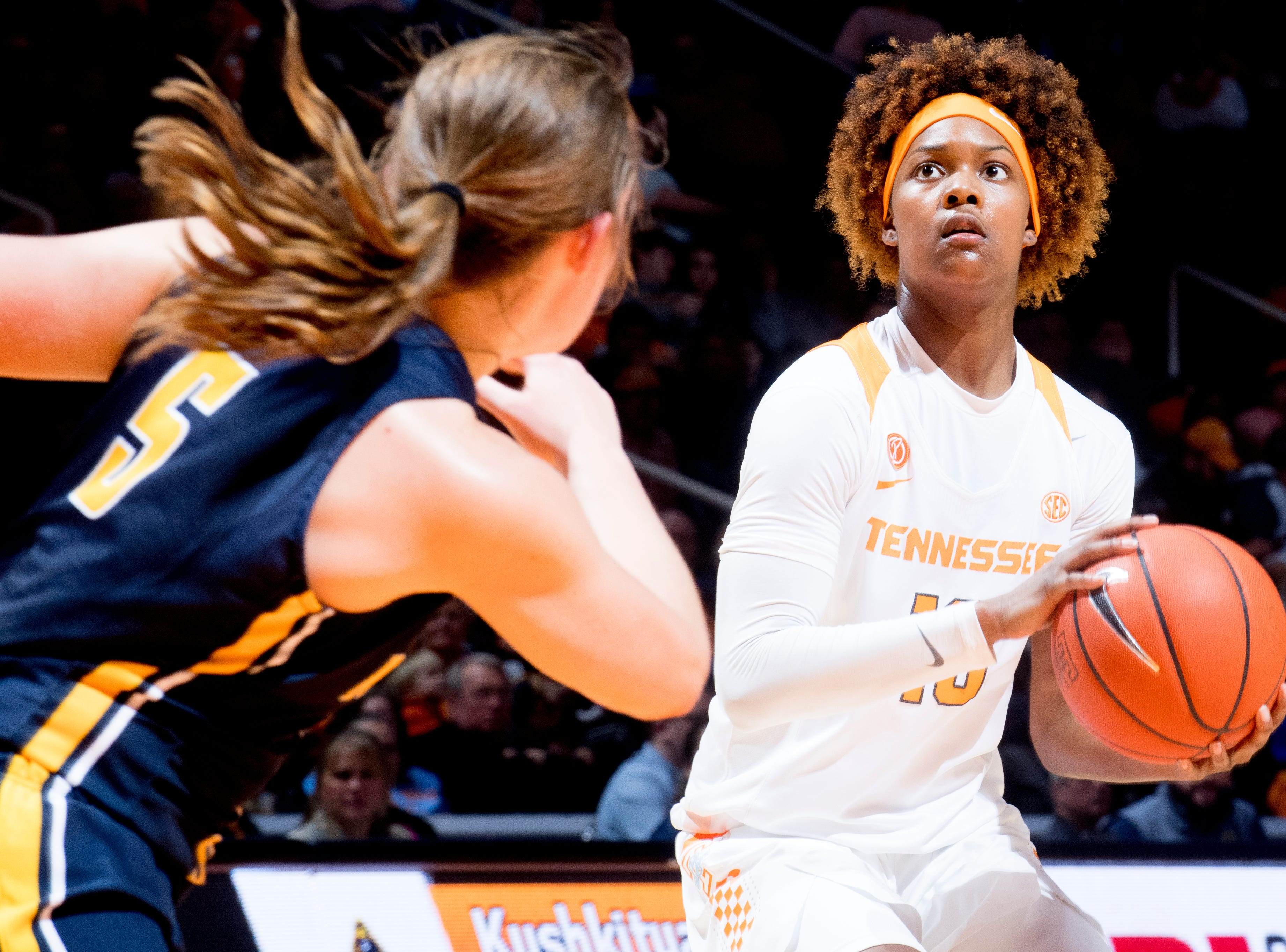 Tennessee guard Jazmine Massengill (13) looks to shoot as Murray State guard Macey Turley (5) defends during a game between the Tennessee Lady Vols and Murray State at Thompson-Boling Arena in Knoxville, Tennessee on Friday, December 28, 2018.
