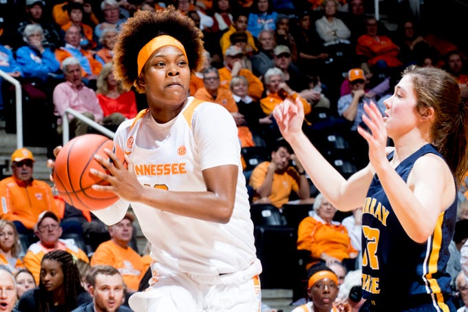 Tennessee guard Jazmine Massengill (13) passes the ball past Murray State forward/guard Alexis Burpo (32) during a game between the Tennessee Lady Vols and Murray State at Thompson-Boling Arena in Knoxville, Tennessee on Friday, December 28, 2018.
