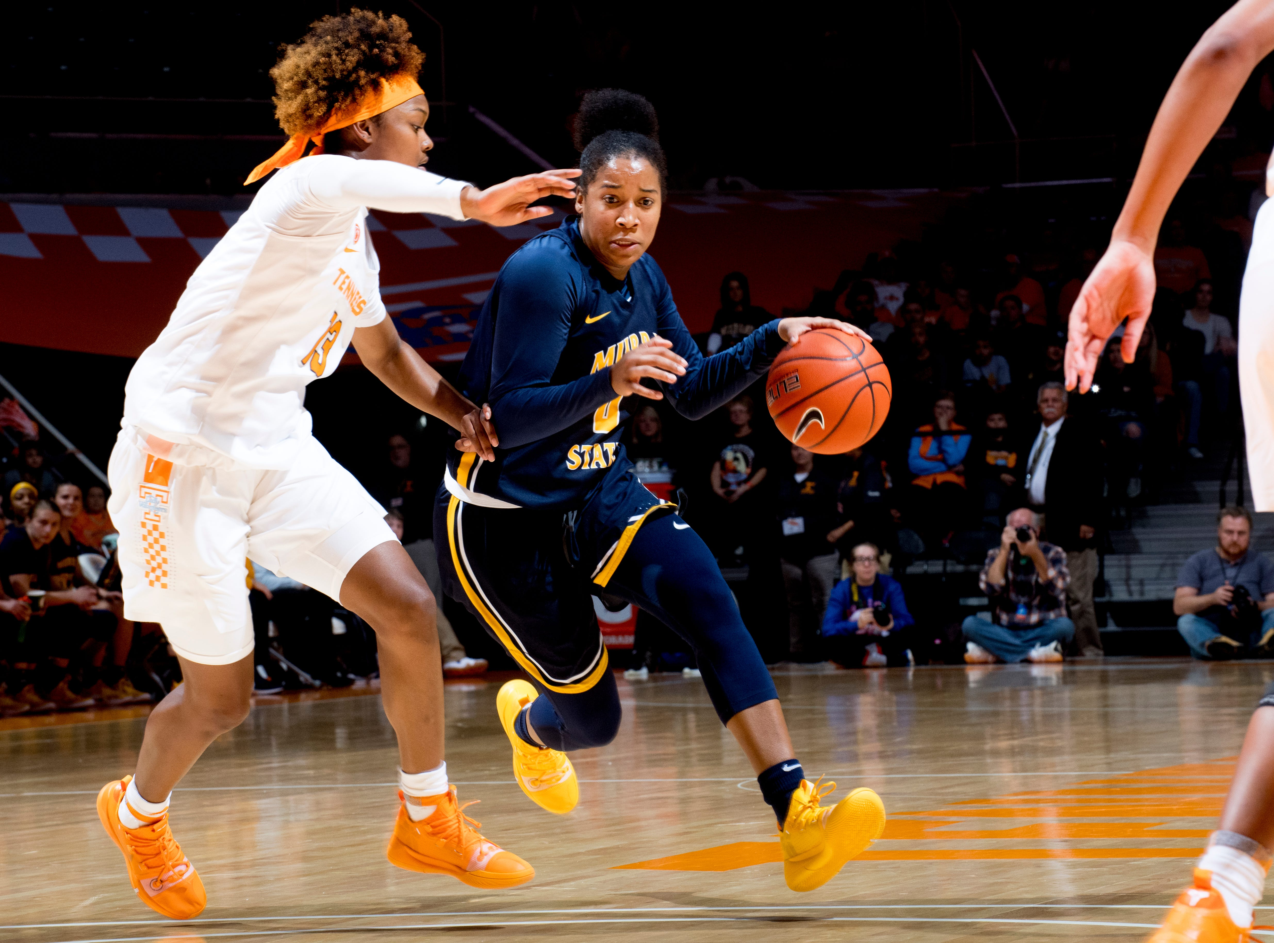 Murray State guard Janika Griffith-Wallace (0) dribbles around Tennessee guard Jazmine Massengill (13) during a game between the Tennessee Lady Vols and Murray State at Thompson-Boling Arena in Knoxville, Tennessee on Friday, December 28, 2018.