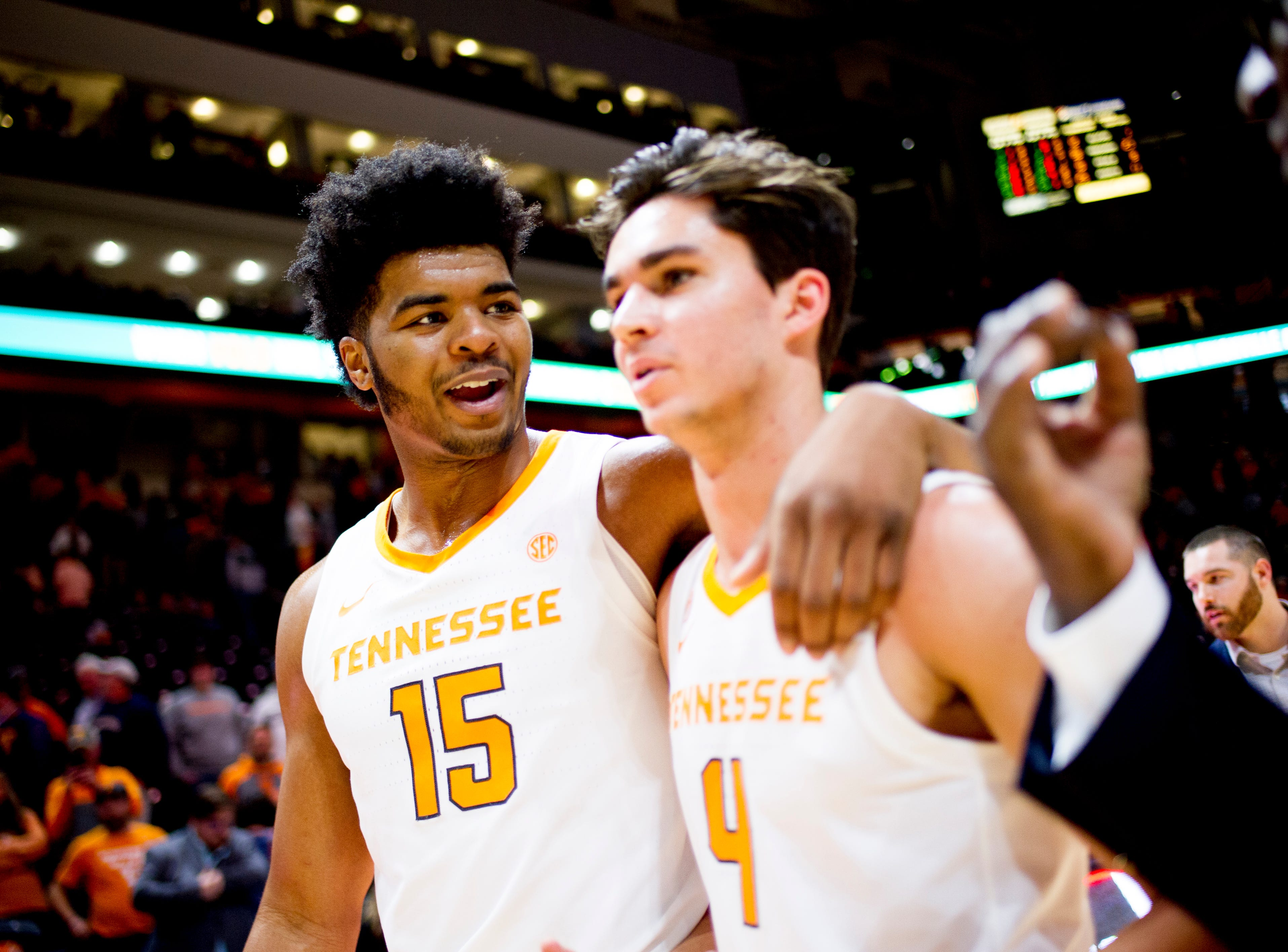 Tennessee forward Derrick Walker (15) and Tennessee guard Jacob Fleschman (4) walks off the field after Tennessee's 96-53 win over Tennessee Tech at Thompson-Boling Arena in Knoxville, Tennessee on Saturday, December 29, 2018.