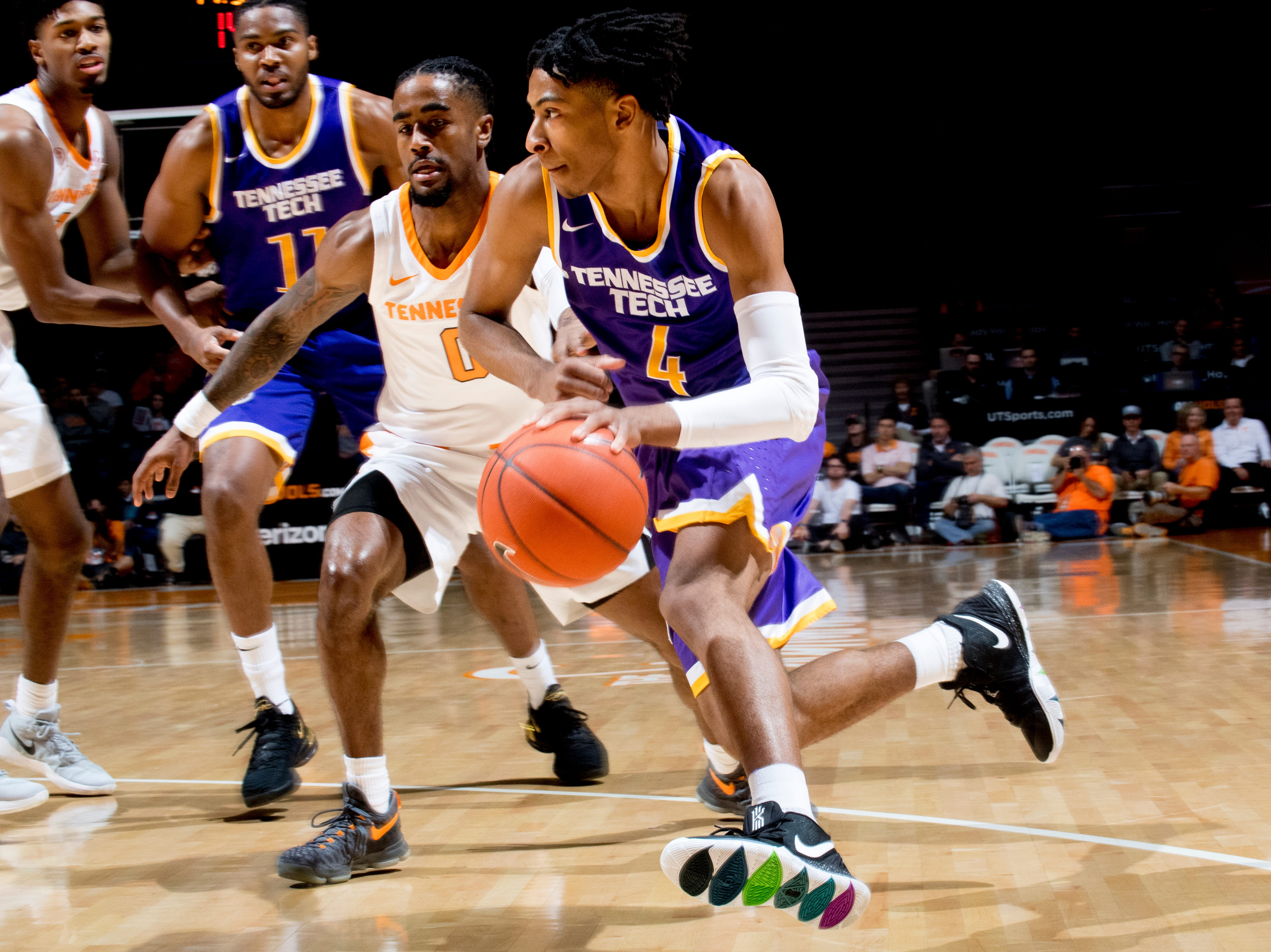 Tennessee Tech guard Jr. Clay (4) dribbles down the court during a game between Tennessee and Tennessee Tech at Thompson-Boling Arena in Knoxville, Tennessee on Saturday, December 29, 2018.