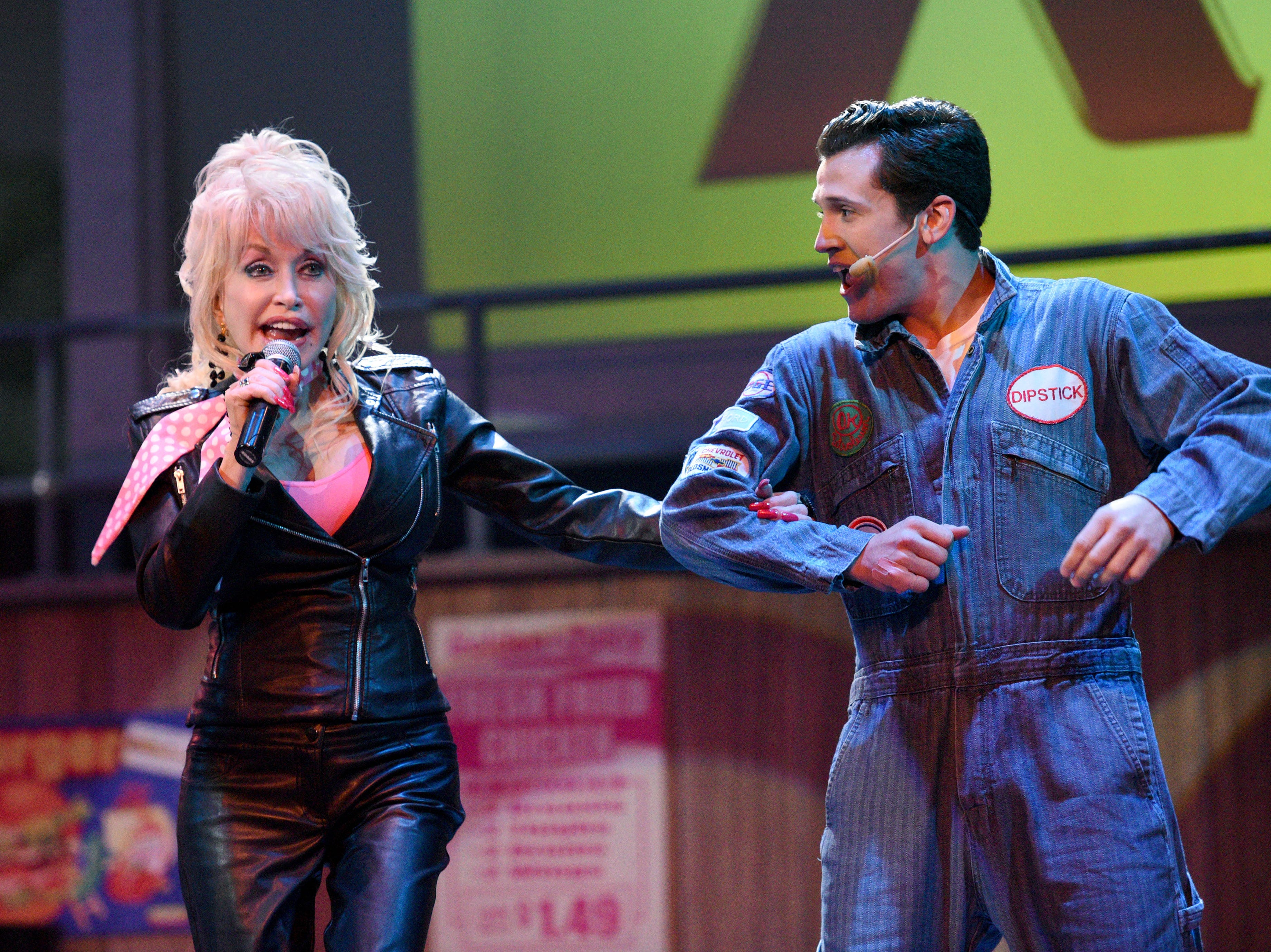 Dolly Parton on stage with Quade Sewell, a member of the Dreamland Drive-in cast, during the announcement of a $22 million wood coaster that will mark the largest attraction investment in the park's history  Friday, Aug. 7, 2015. The Lightning Rod is the world's fastest, first launching wood coater and construction is expect to be ready in 2016.