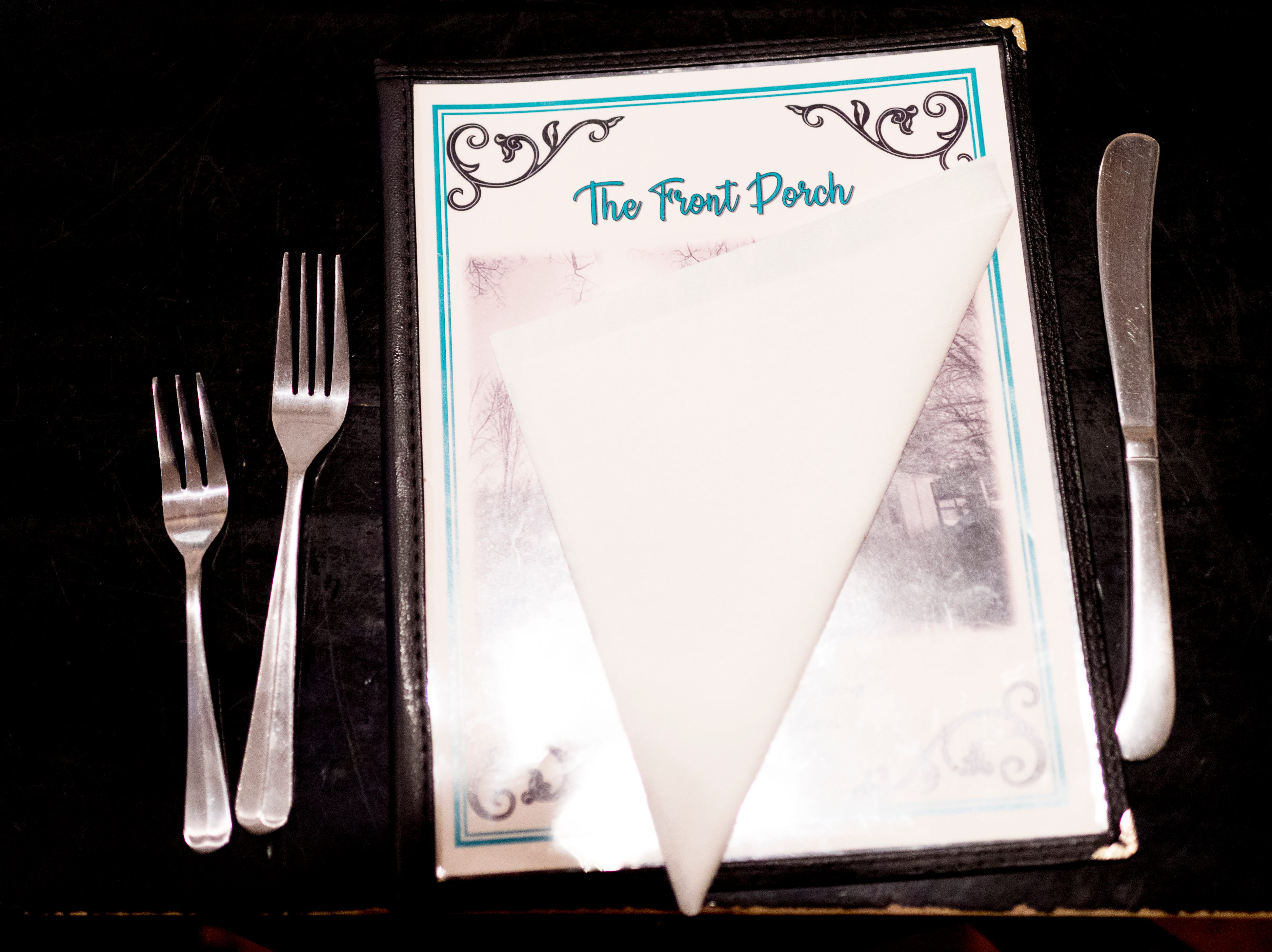 The menu sits on a table at The Front Porch Restaurant in Powell, Tennessee on Saturday, December 29, 2018. For five years, owner Bart Elkins has worked to revive that experience of the front porch being used as the focus for family and friends.