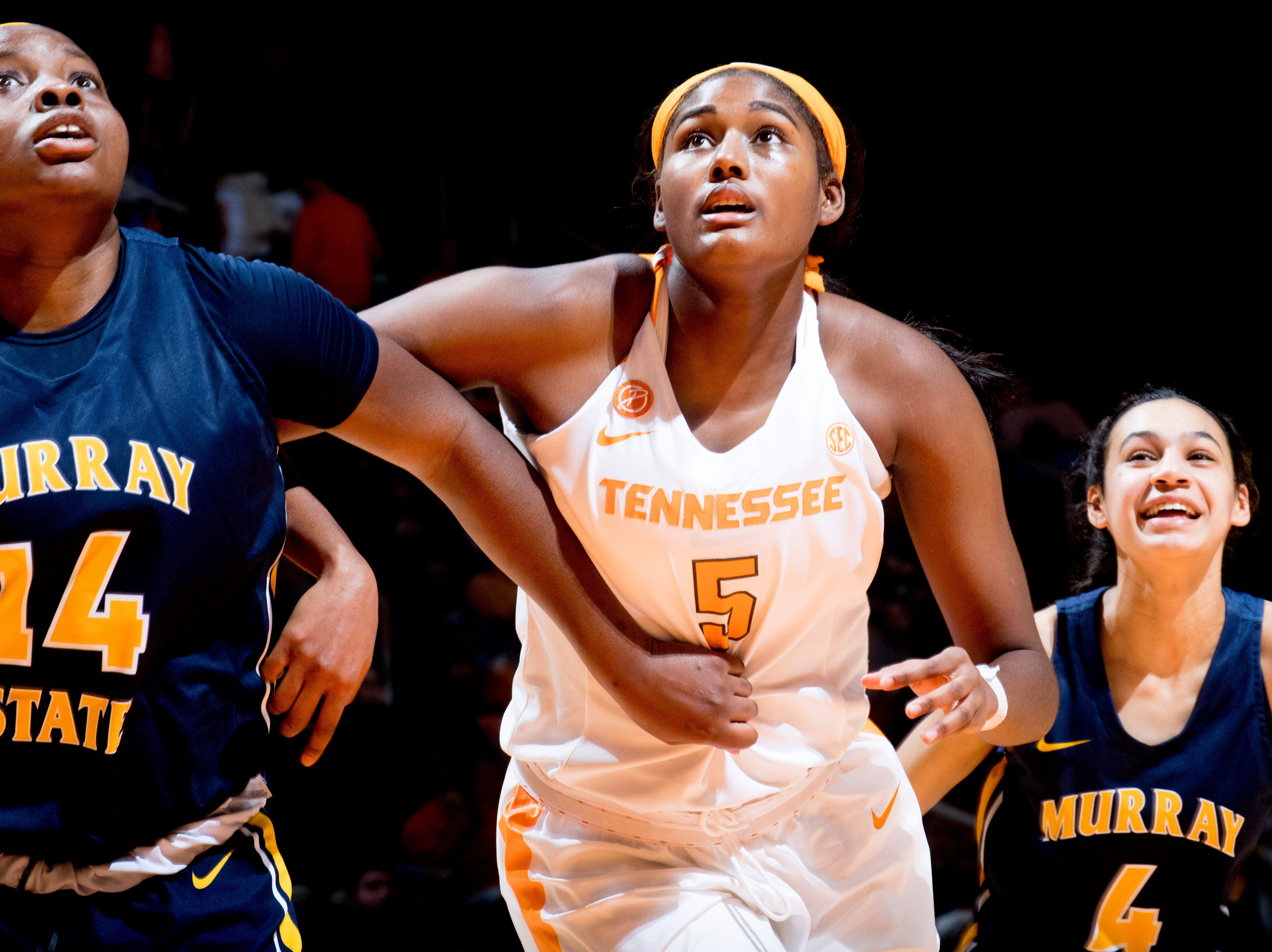 Tennessee center Kamera Harris (5), Murray State forward Evelyn Adebayo (14) and Murray State guard Lex Mayes (4) eye the rebound ball during a game between the Tennessee Lady Vols and Murray State at Thompson-Boling Arena in Knoxville, Tennessee on Friday, December 28, 2018.