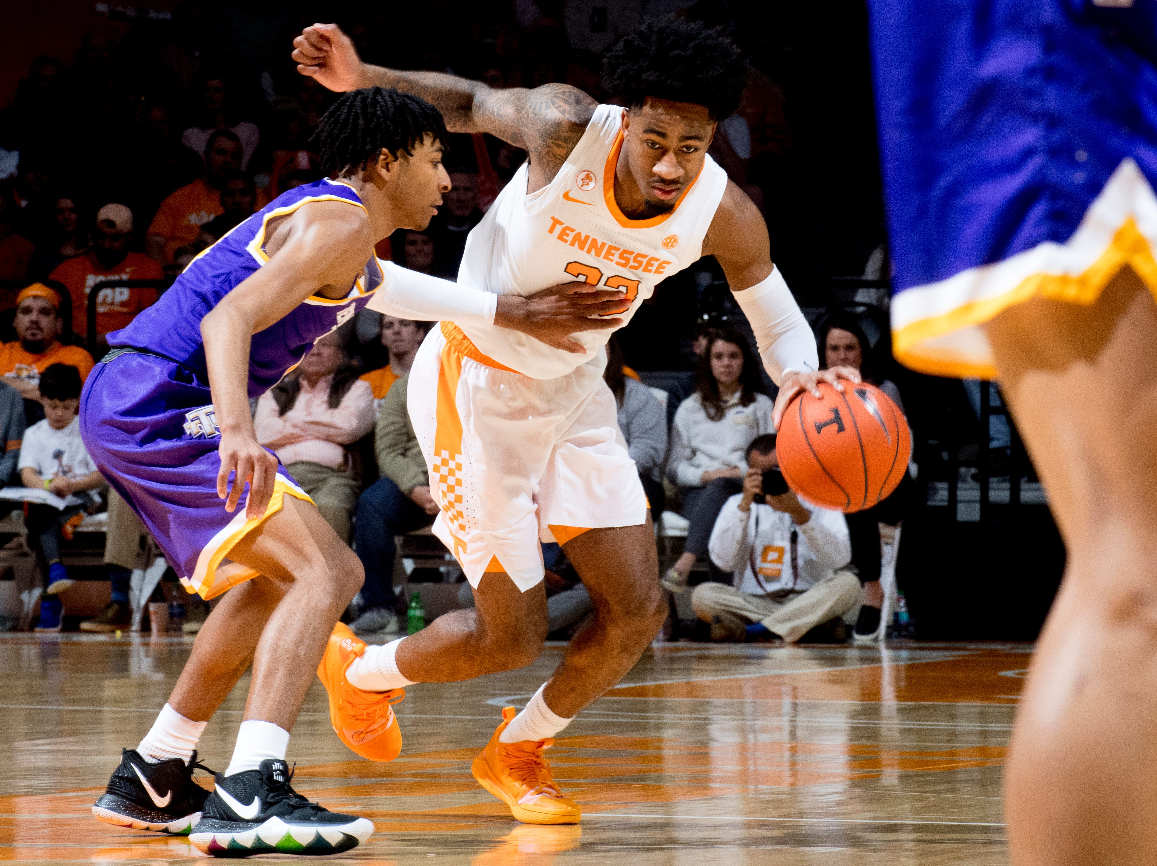 Tennessee guard Jordan Bowden (23) dribbles past Tennessee Tech guard Jr. Clay (4) during a game between Tennessee and Tennessee Tech at Thompson-Boling Arena in Knoxville, Tennessee on Saturday, December 29, 2018.