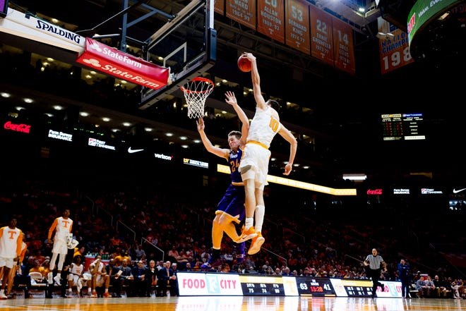 Tennessee forward John Fulkerson (10) dunks over Tennessee Tech forward Garrett Golday (24) during a game between Tennessee and Tennessee Tech at Thompson-Boling Arena in Knoxville, Tennessee on Saturday, December 29, 2018.