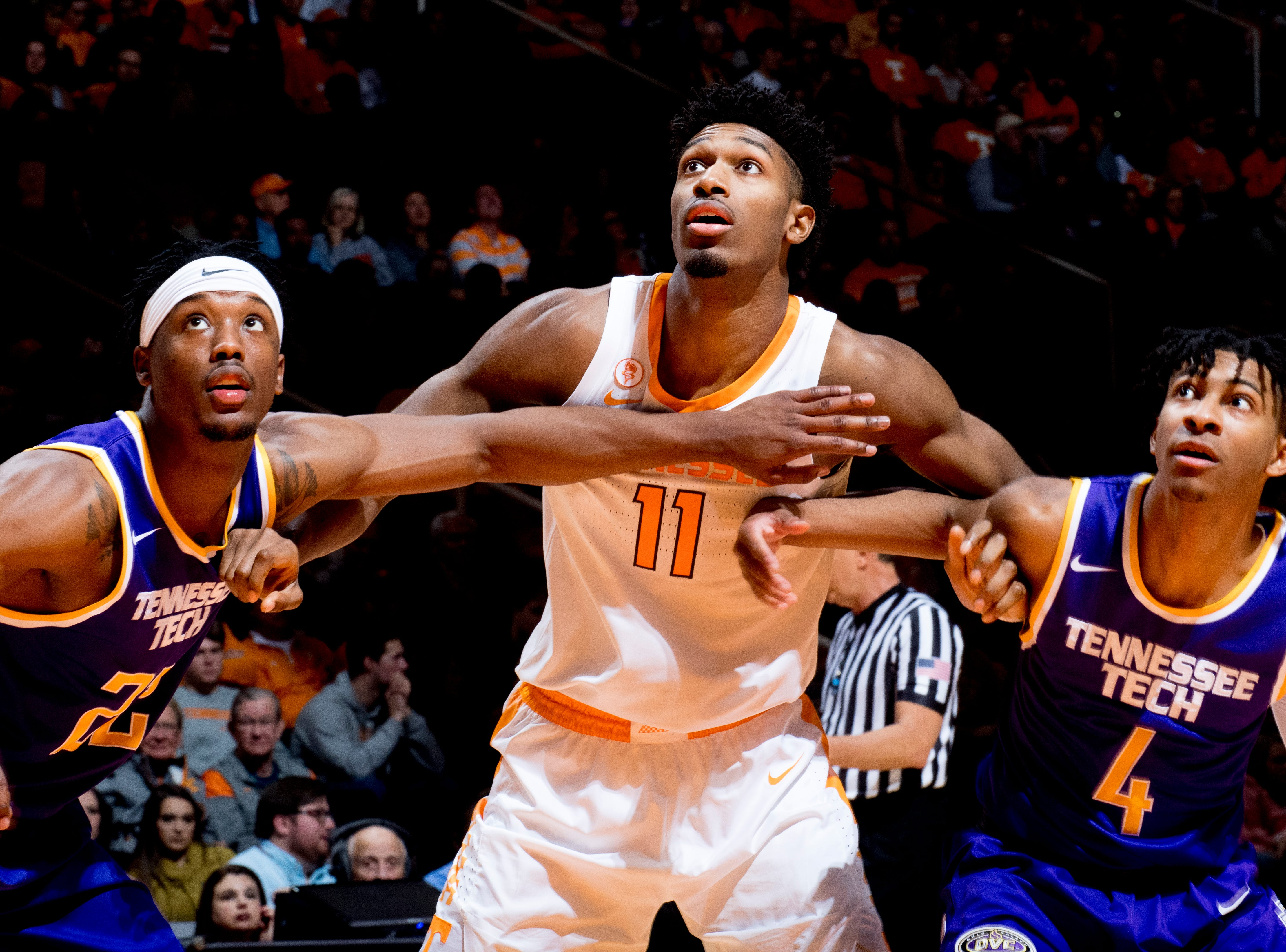 Tennessee forward Kyle Alexander (11), Tennessee Tech forward Courtney Alexander II (22) and Tennessee Tech guard Jr. Clay (4) eye the rebound ball during a game between Tennessee and Tennessee Tech at Thompson-Boling Arena in Knoxville, Tennessee on Saturday, December 29, 2018.