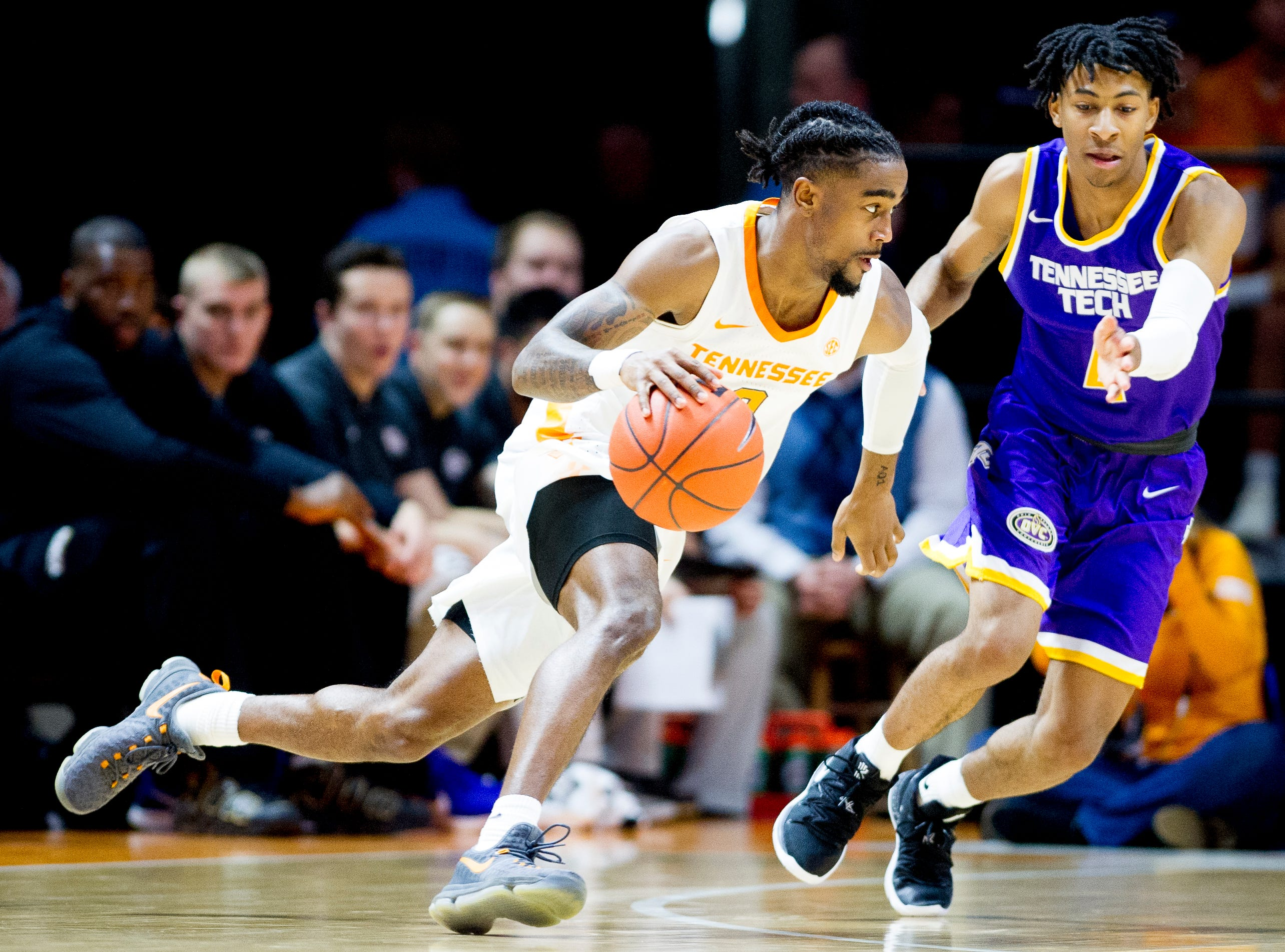 Tennessee guard Jordan Bone (0) dribbles around Tennessee Tech guard Jr. Clay (4) during a game between Tennessee and Tennessee Tech at Thompson-Boling Arena in Knoxville, Tennessee on Saturday, December 29, 2018.
