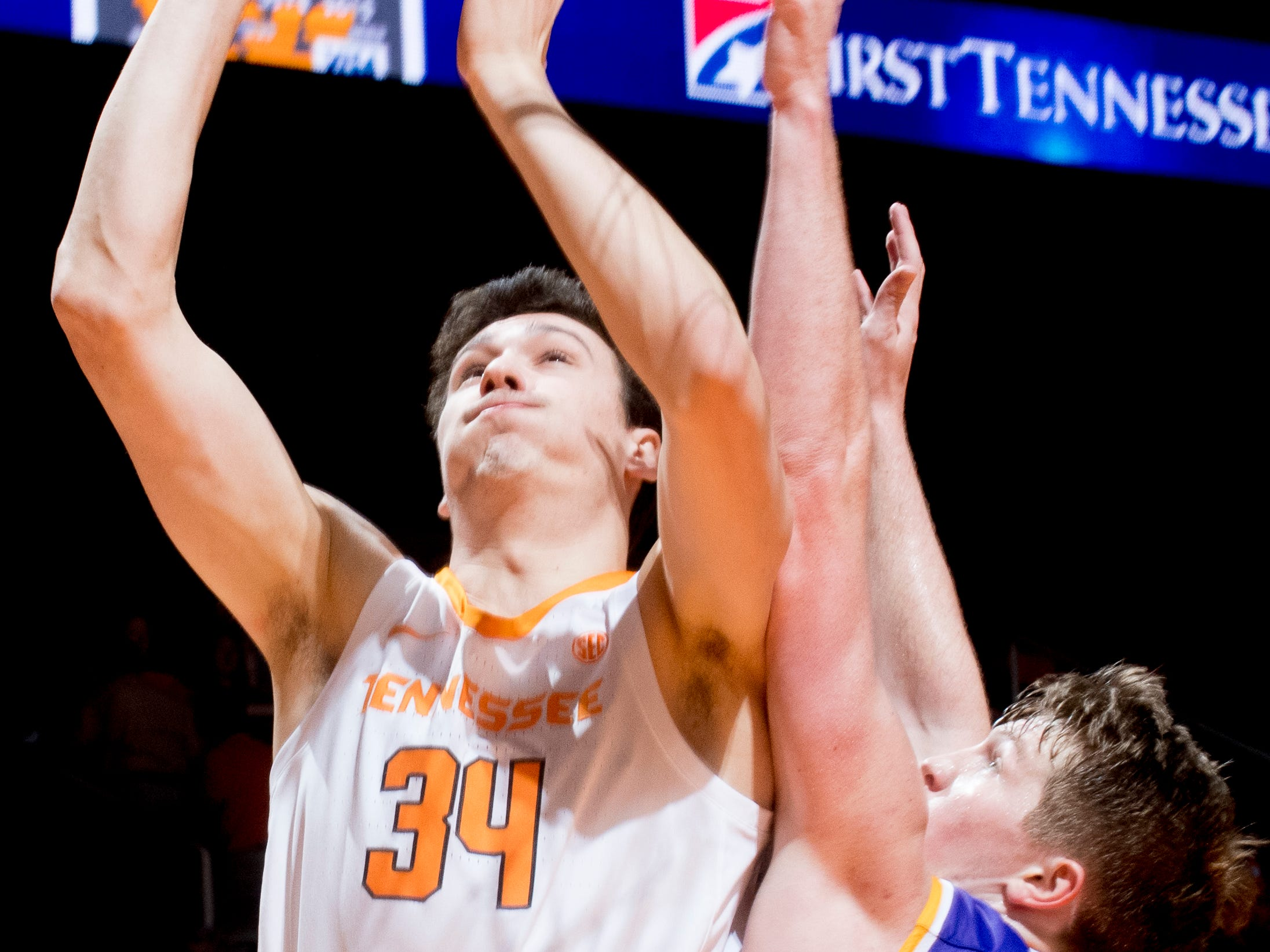 Tennessee forward Brock Jancek (34) shoots a layup past Tennessee Tech forward Garrett Golday (24) during a game between Tennessee and Tennessee Tech at Thompson-Boling Arena in Knoxville, Tennessee on Saturday, December 29, 2018.