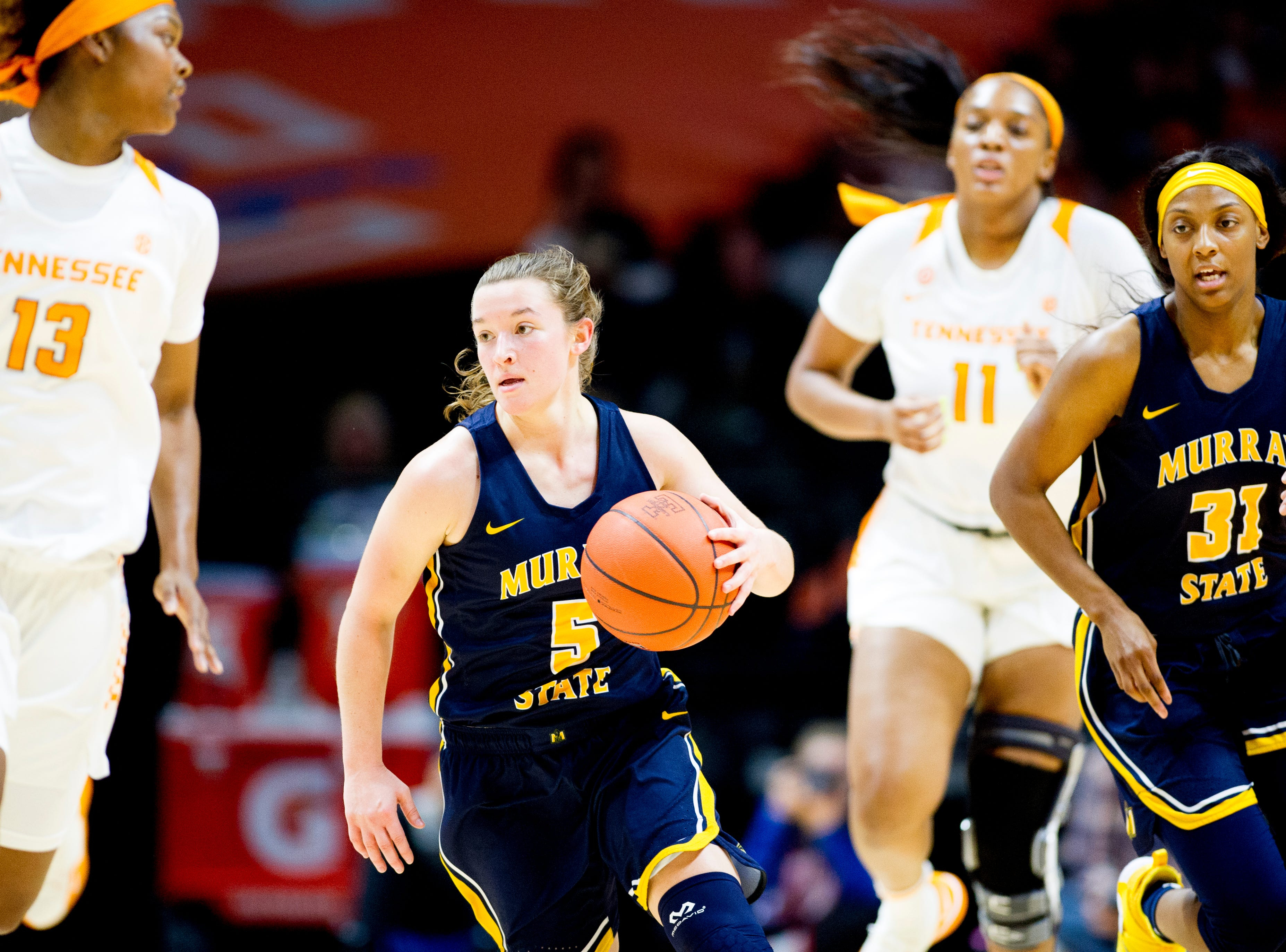 Murray State guard Macey Turley (5) dribbles down the court during a game between the Tennessee Lady Vols and Murray State at Thompson-Boling Arena in Knoxville, Tennessee on Friday, December 28, 2018.