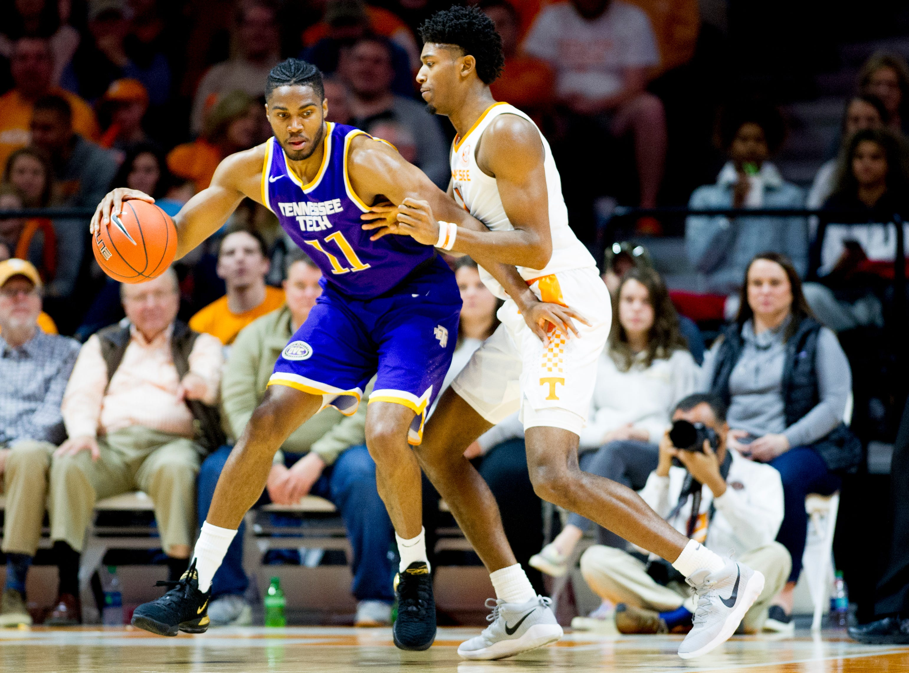 Tennessee Tech center Micaiah Henry (11) tries to dribble around Tennessee forward Kyle Alexander (11) during a game between Tennessee and Tennessee Tech at Thompson-Boling Arena in Knoxville, Tennessee on Saturday, December 29, 2018.