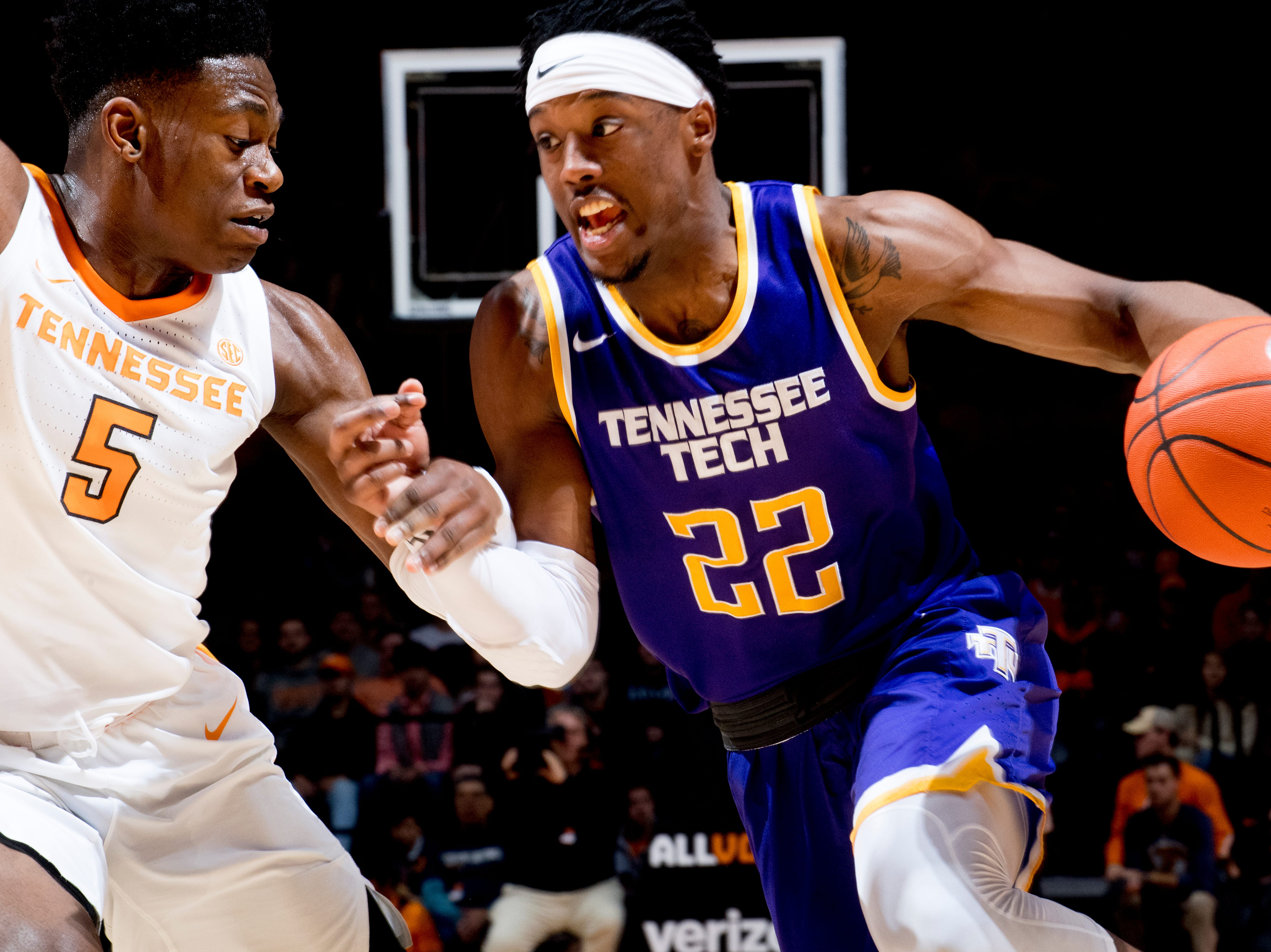 Tennessee Tech forward Courtney Alexander II (22) dribbles around Tennessee guard Admiral Schofield (5) during a game between Tennessee and Tennessee Tech at Thompson-Boling Arena in Knoxville, Tennessee on Saturday, December 29, 2018.