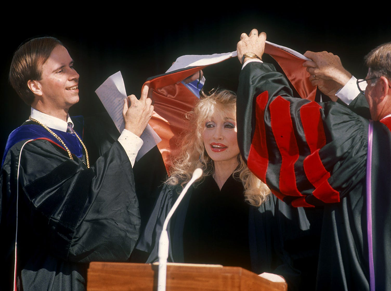 Mr. Michael carter, VP of Academic Affairs (left) and Dr. Cordell Maddox, President of Carson-Newman confer an honorary degree on Dolly Parton on Oct 21, 1990.