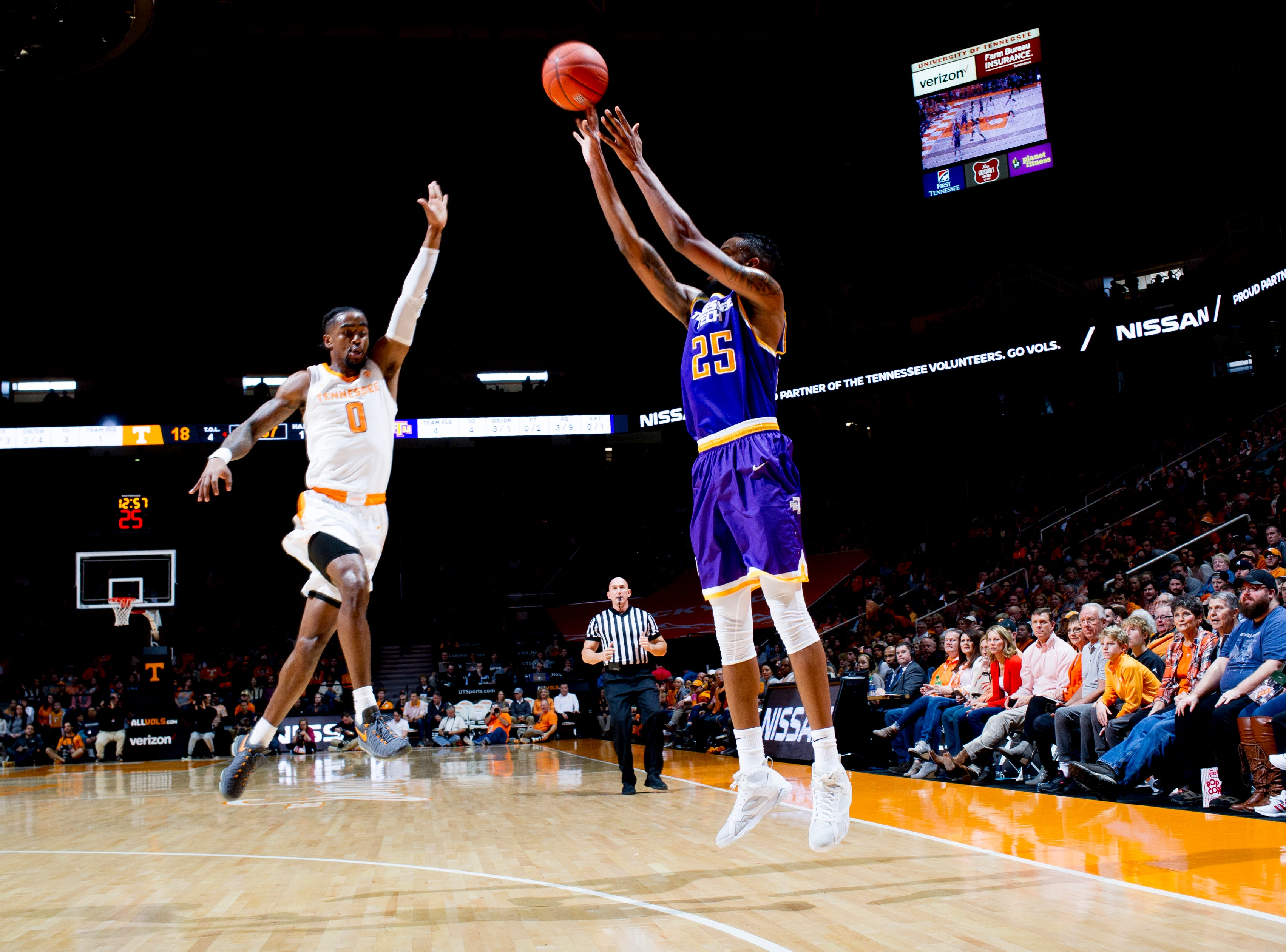 Tennessee Tech forward Malik Martin (25) shoots the ball as Tennessee guard Jordan Bone (0) defends during a game between Tennessee and Tennessee Tech at Thompson-Boling Arena in Knoxville, Tennessee on Saturday, December 29, 2018.