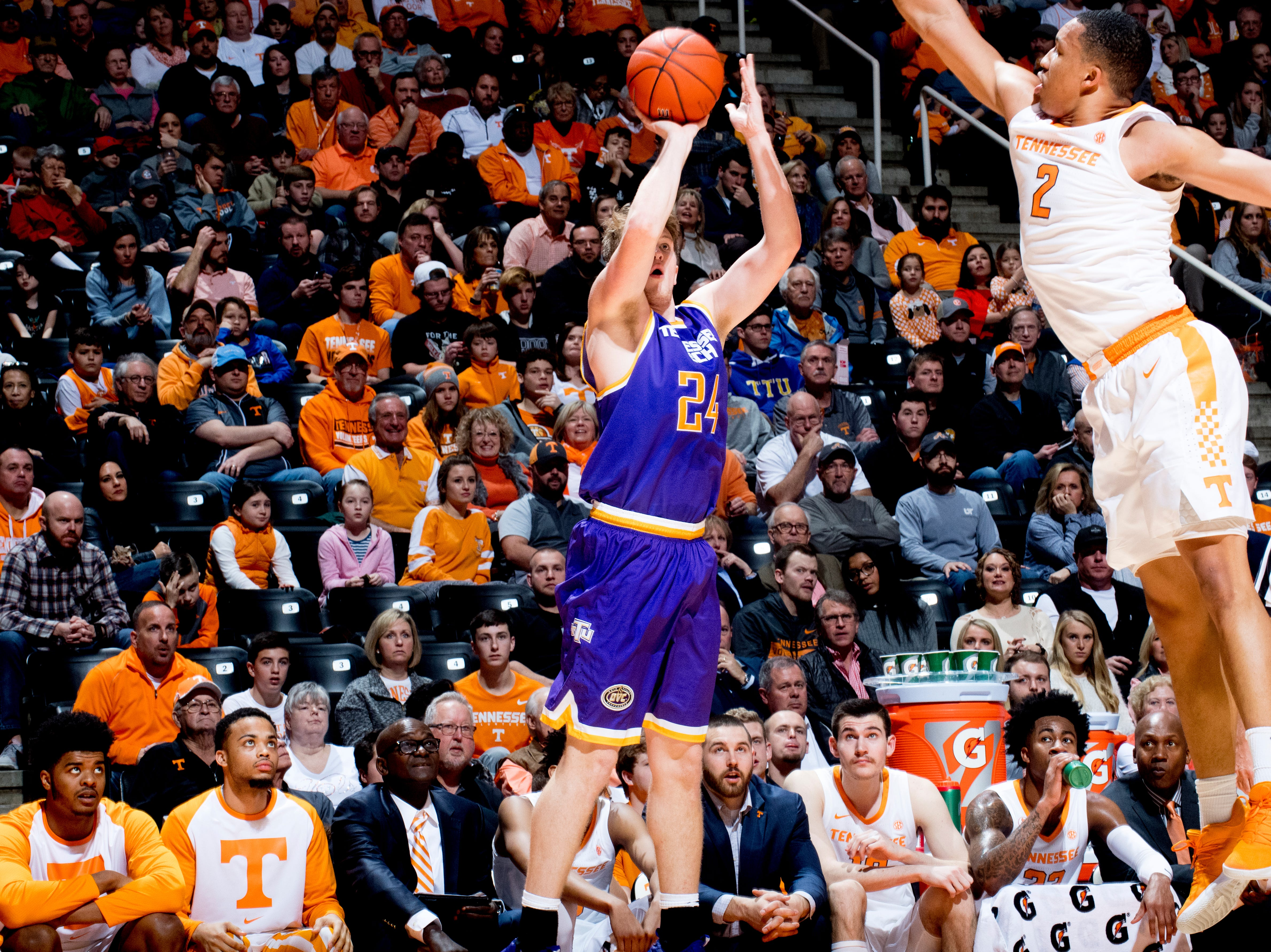 Tennessee Tech forward Garrett Golday (24) takes a shot as Tennessee forward Grant Williams (2) defends during a game between Tennessee and Tennessee Tech at Thompson-Boling Arena in Knoxville, Tennessee on Saturday, December 29, 2018.