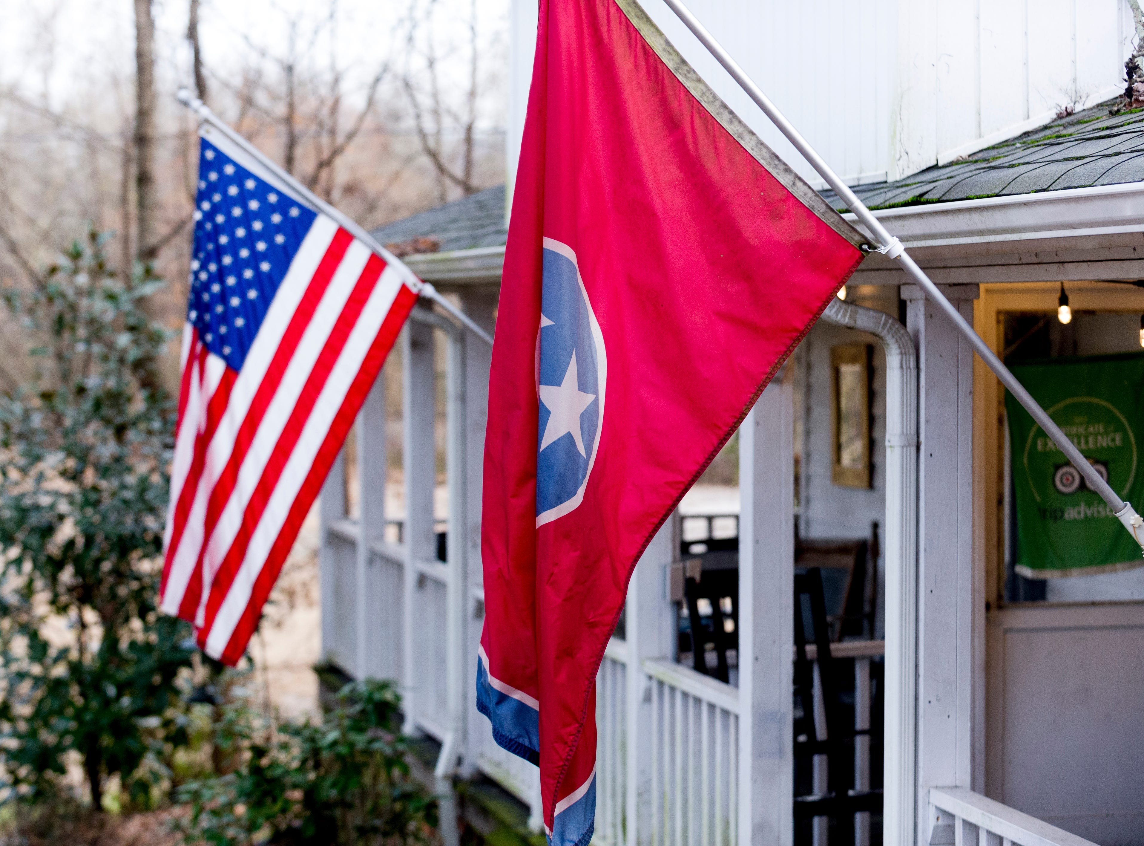 Flags adorn the porch at The Front Porch Restaurant in Powell, Tennessee on Saturday, December 29, 2018. For five years, owner Bart Elkins has worked to revive that experience of the front porch being used as the focus for family and friends.
