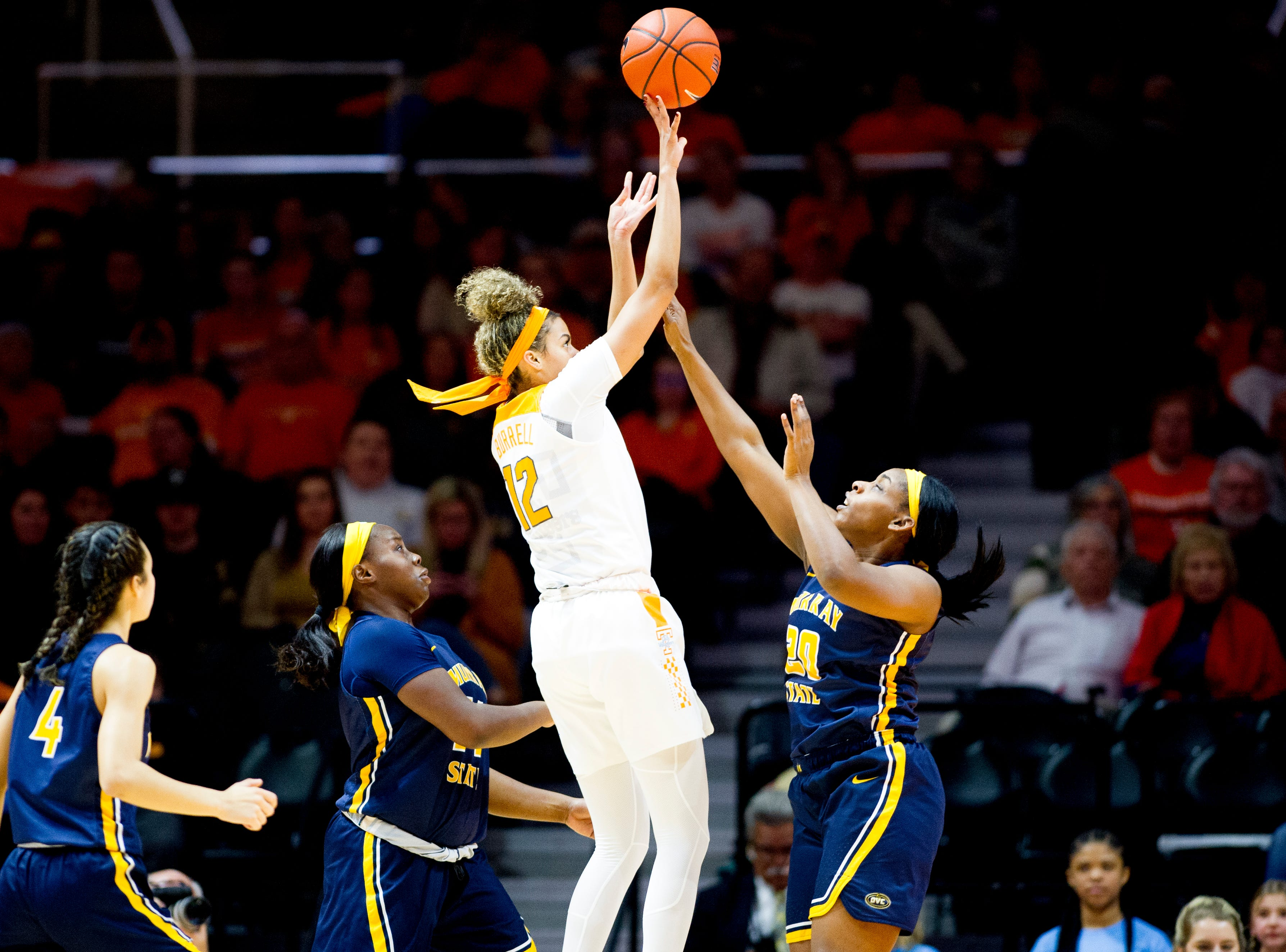 Tennessee guard/forward Rae Burrell (12) takes a shot past Murray State forward Cekeya Mack (20) during a game between the Tennessee Lady Vols and Murray State at Thompson-Boling Arena in Knoxville, Tennessee on Friday, December 28, 2018.