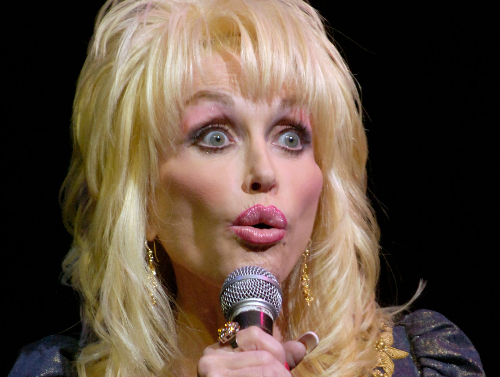 Dolly Parton at Dollywood on Friday making several announcements including the winner of her cookbook contest which is having a cookout for 100 people including Dolly herself.