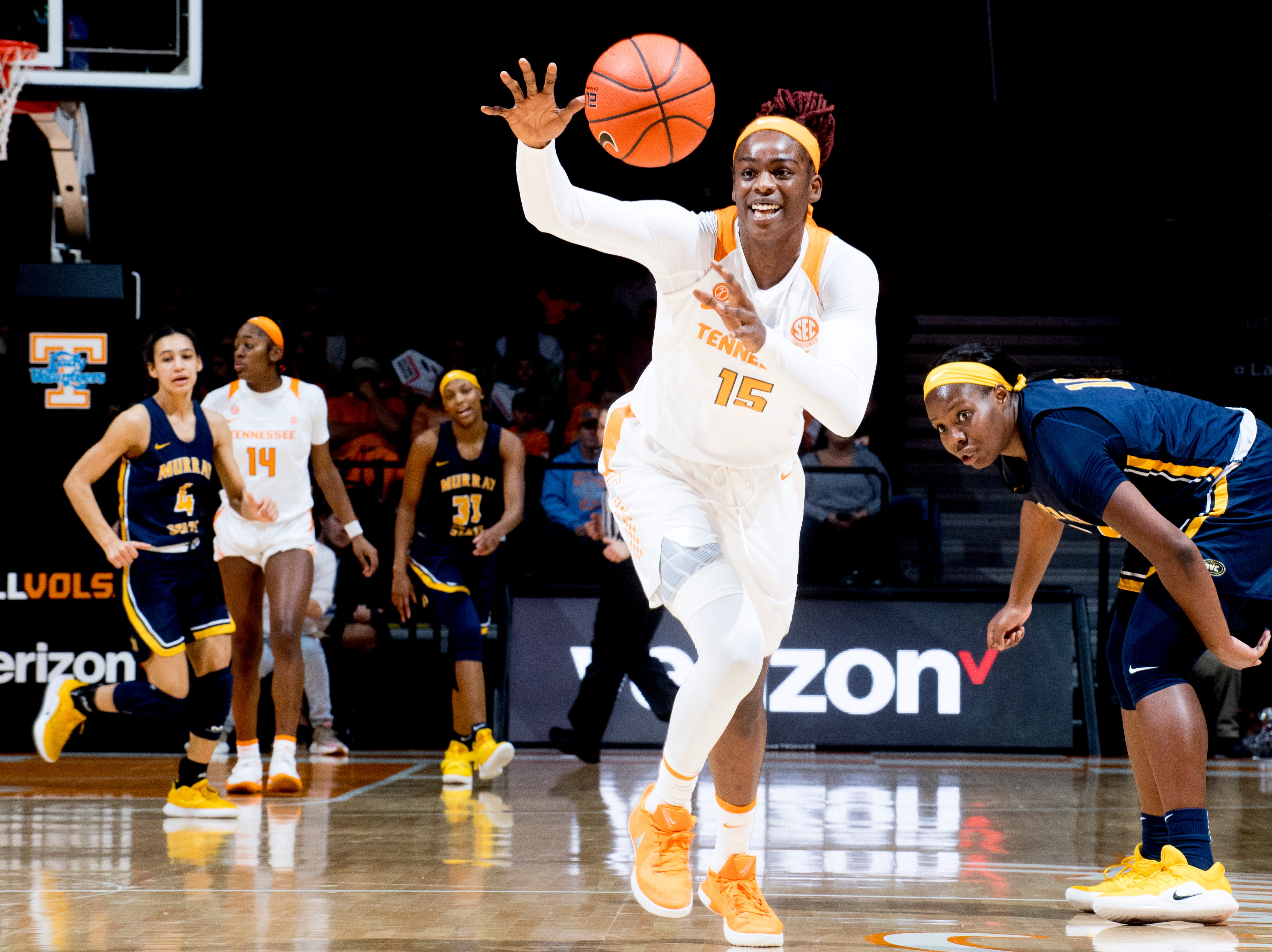 Tennessee forward Cheridene Green (15) takes possession of a ball intended for Murray State guard/forward Paige Barrett (11) during a game between the Tennessee Lady Vols and Murray State at Thompson-Boling Arena in Knoxville, Tennessee on Friday, December 28, 2018.