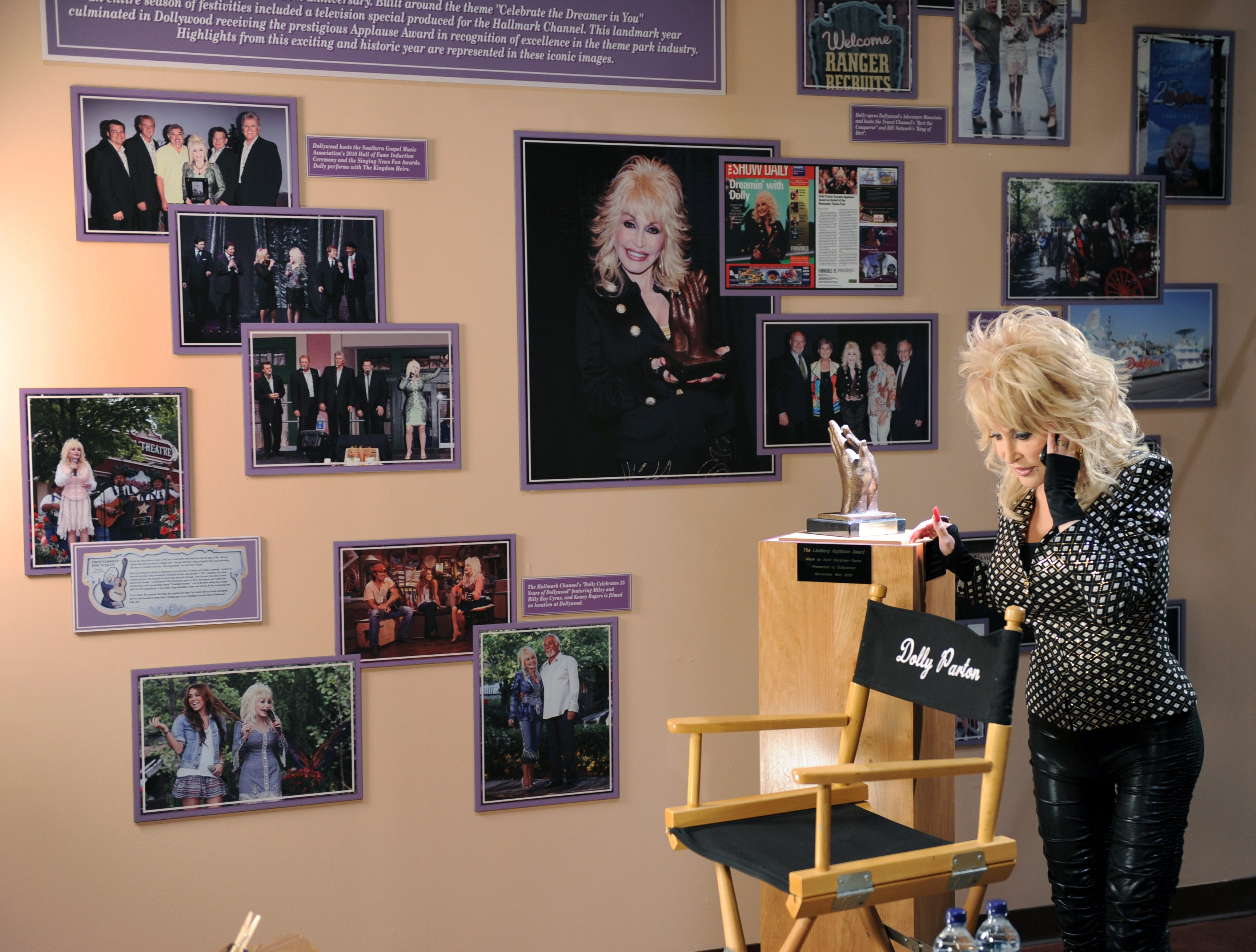 Dolly Parton takes a quick phone call Friday, May. 6, 2011 in between interviews talking about Dollywood winning The Liseberg Applause Award.