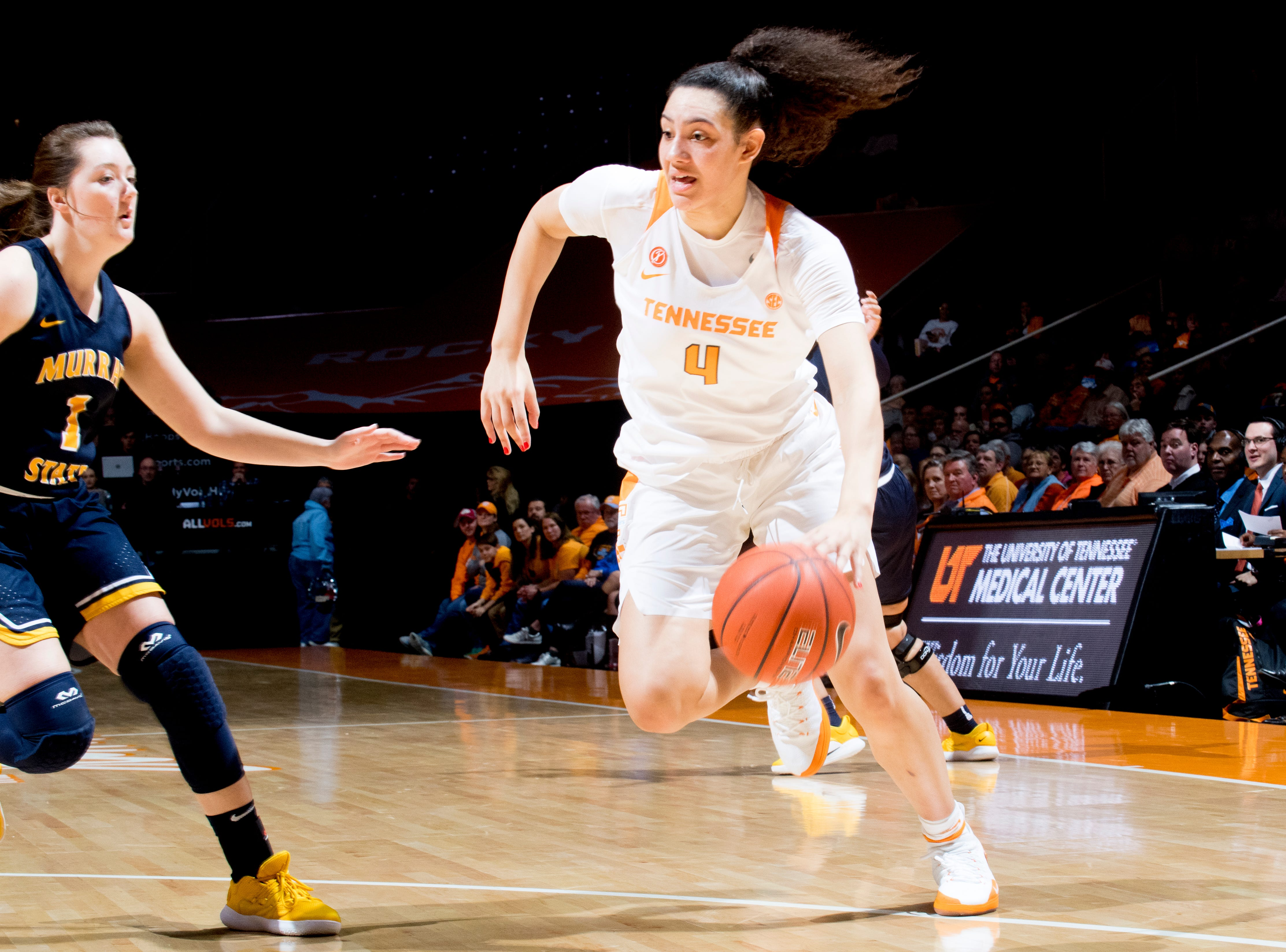 Tennessee forward Mimi Collins (4) dribbles the ball as Murray State guard Raegan Blackburn (1) defends during a game between the Tennessee Lady Vols and Murray State at Thompson-Boling Arena in Knoxville, Tennessee on Friday, December 28, 2018.