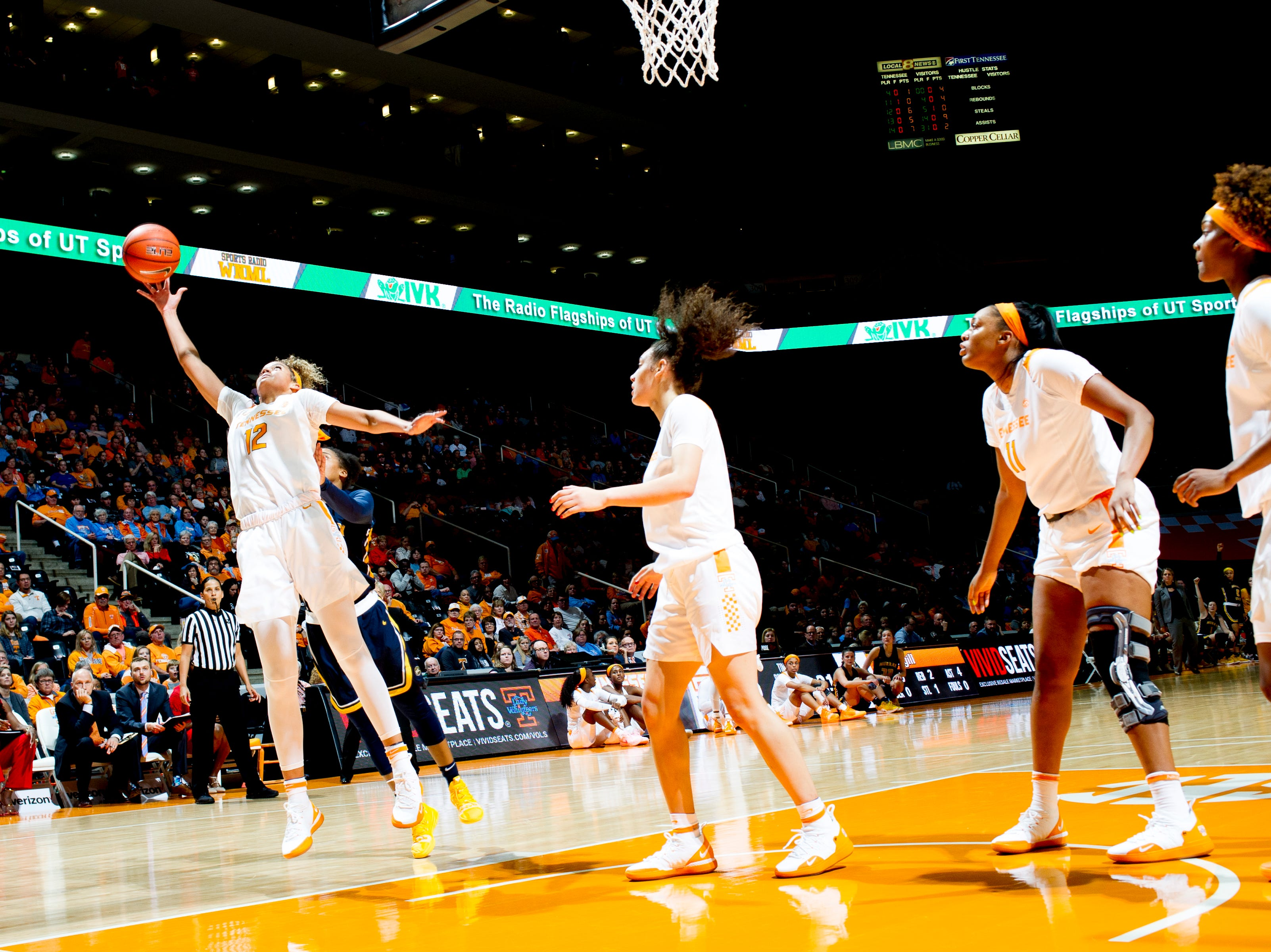 Tennessee guard/forward Rae Burrell (12) goes for a loose ball during a game between the Tennessee Lady Vols and Murray State at Thompson-Boling Arena in Knoxville, Tennessee on Friday, December 28, 2018.