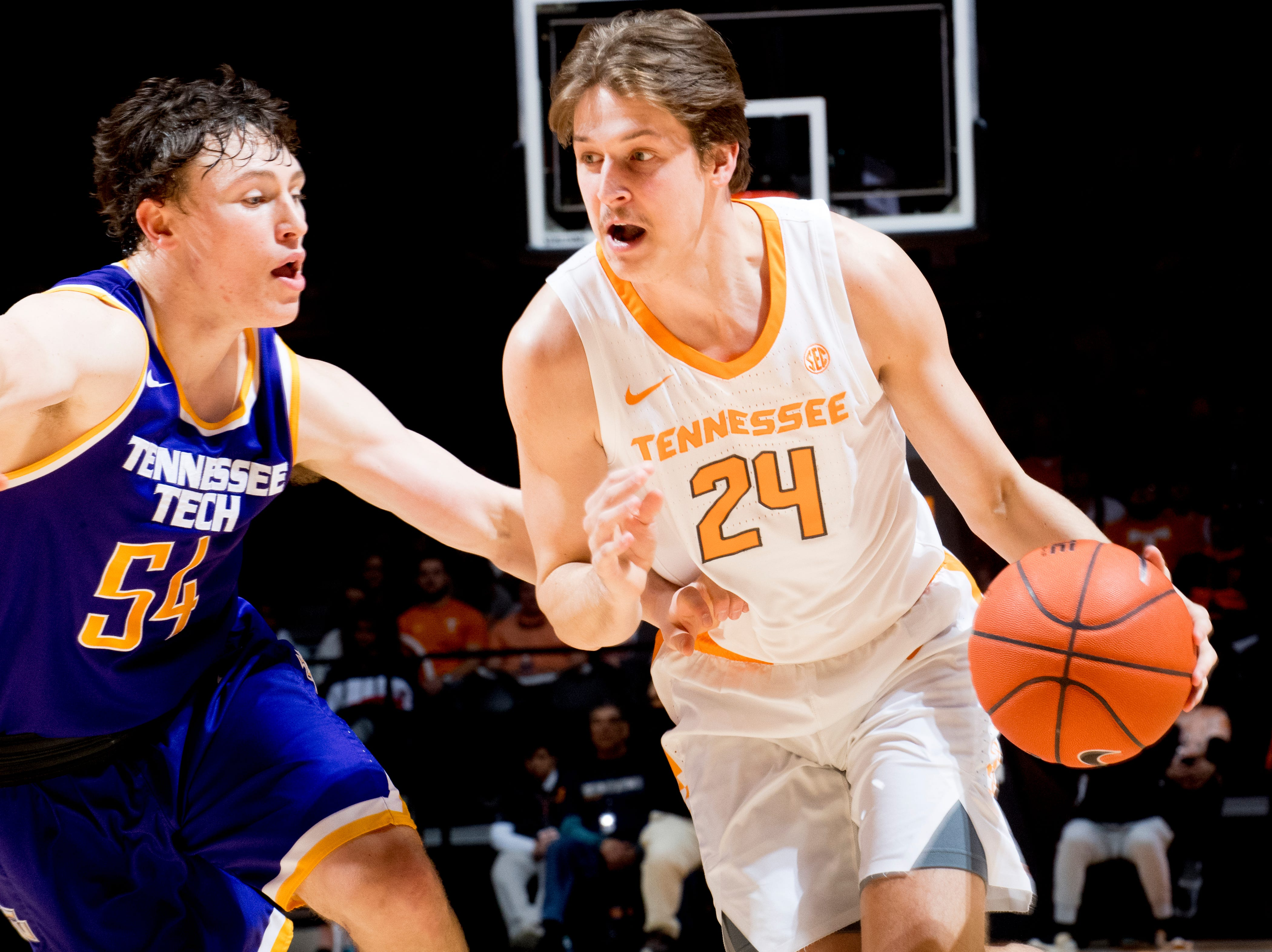 Tennessee guard Lucas Campbell (24) dribbles the ball around Tennessee Tech guard Cade Crosland (54) during a game between Tennessee and Tennessee Tech at Thompson-Boling Arena in Knoxville, Tennessee on Saturday, December 29, 2018.