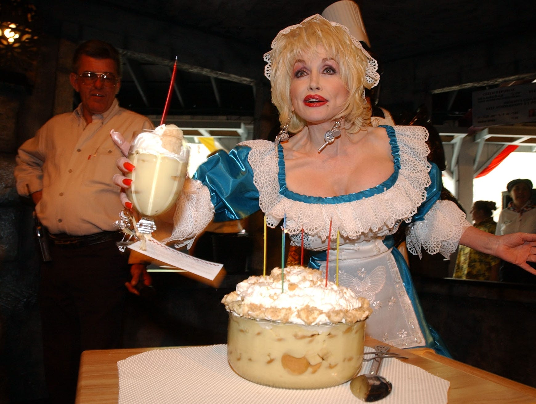 Dolly Parton serves dessert to reporters during media day at Dollywood Friday.  Dolly was announcing the opening of her Festival of Nations which opens Saturday, April 5, 2003