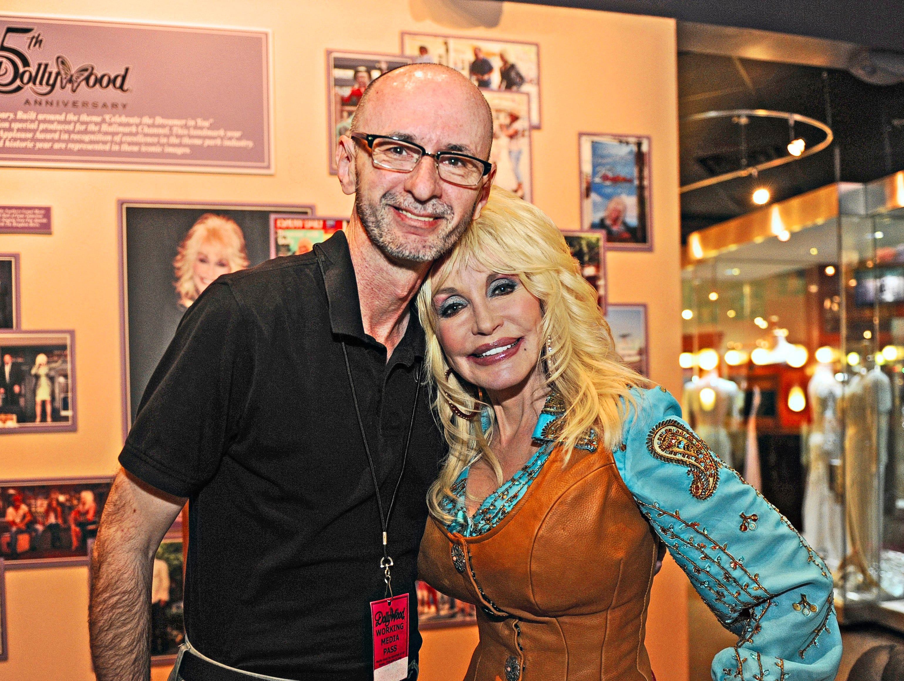 Dolly Parton poses with News Sentinel reporter Terry Morrow at Dollywood Friday, Mar. 23, 2012.