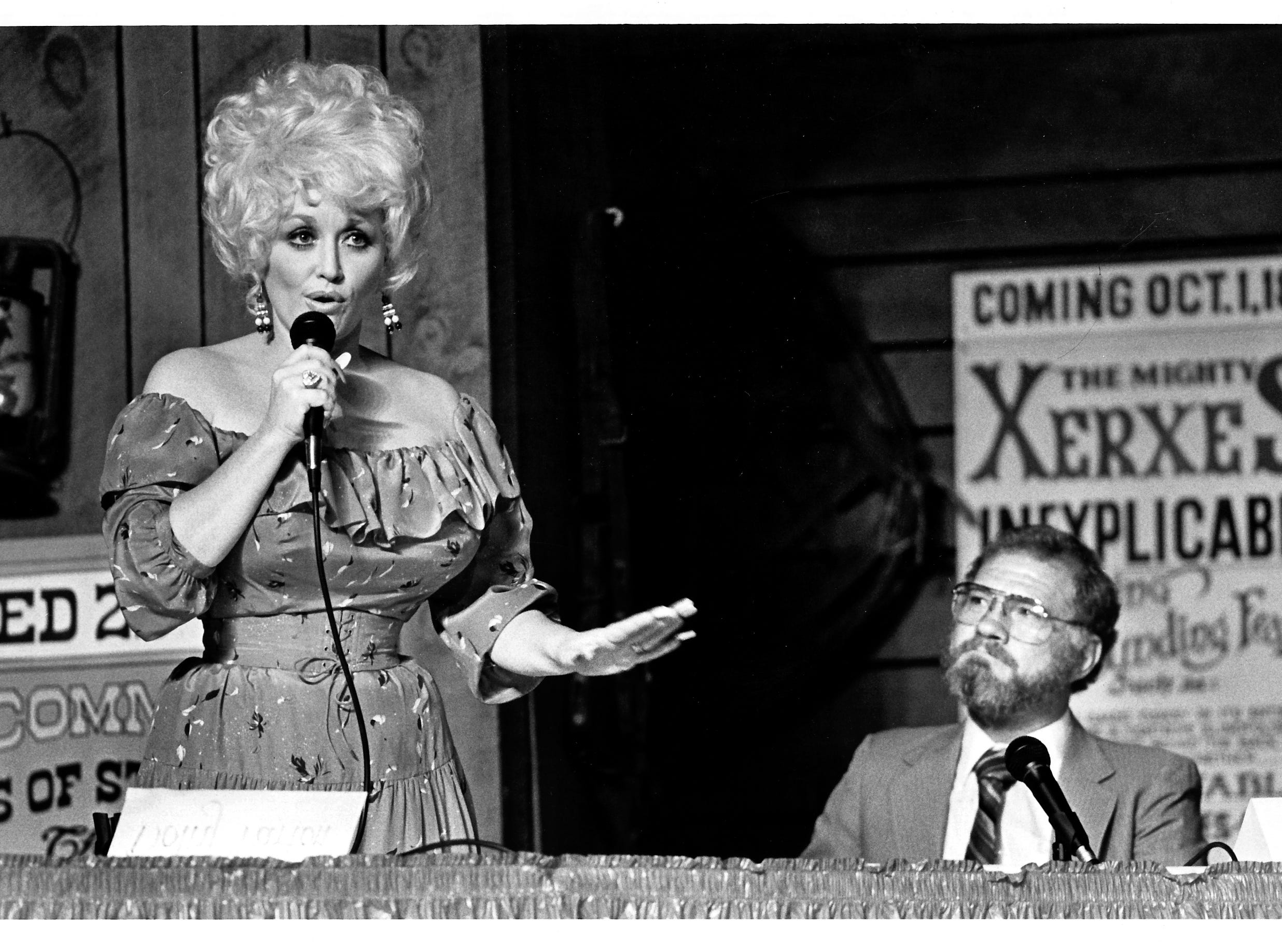 Entertainer Dolly Parton thanks citizens of Silver Dollar City for their support, while Silver Dollar City Mayor Ted Miller listens November 27, 1985.