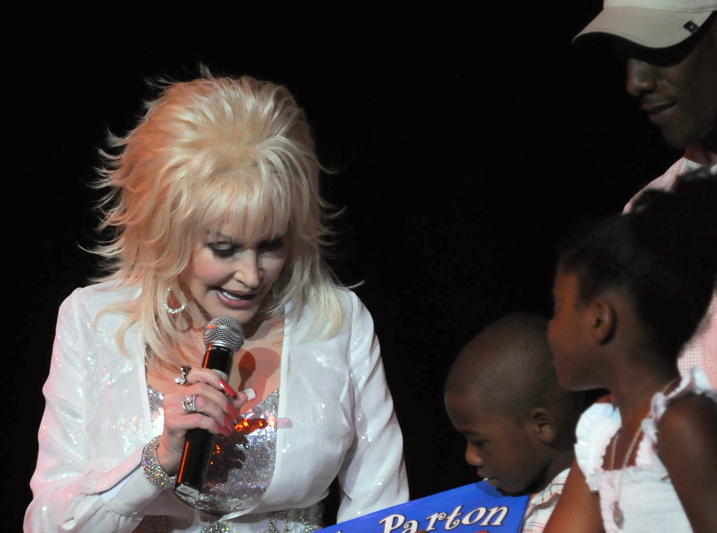 Dolly Parton presents the 25th million Imagination Library to book to Kumar and Shinera Stewart, from Birminham, Ala., on June 11, 2010 at Dollywood.