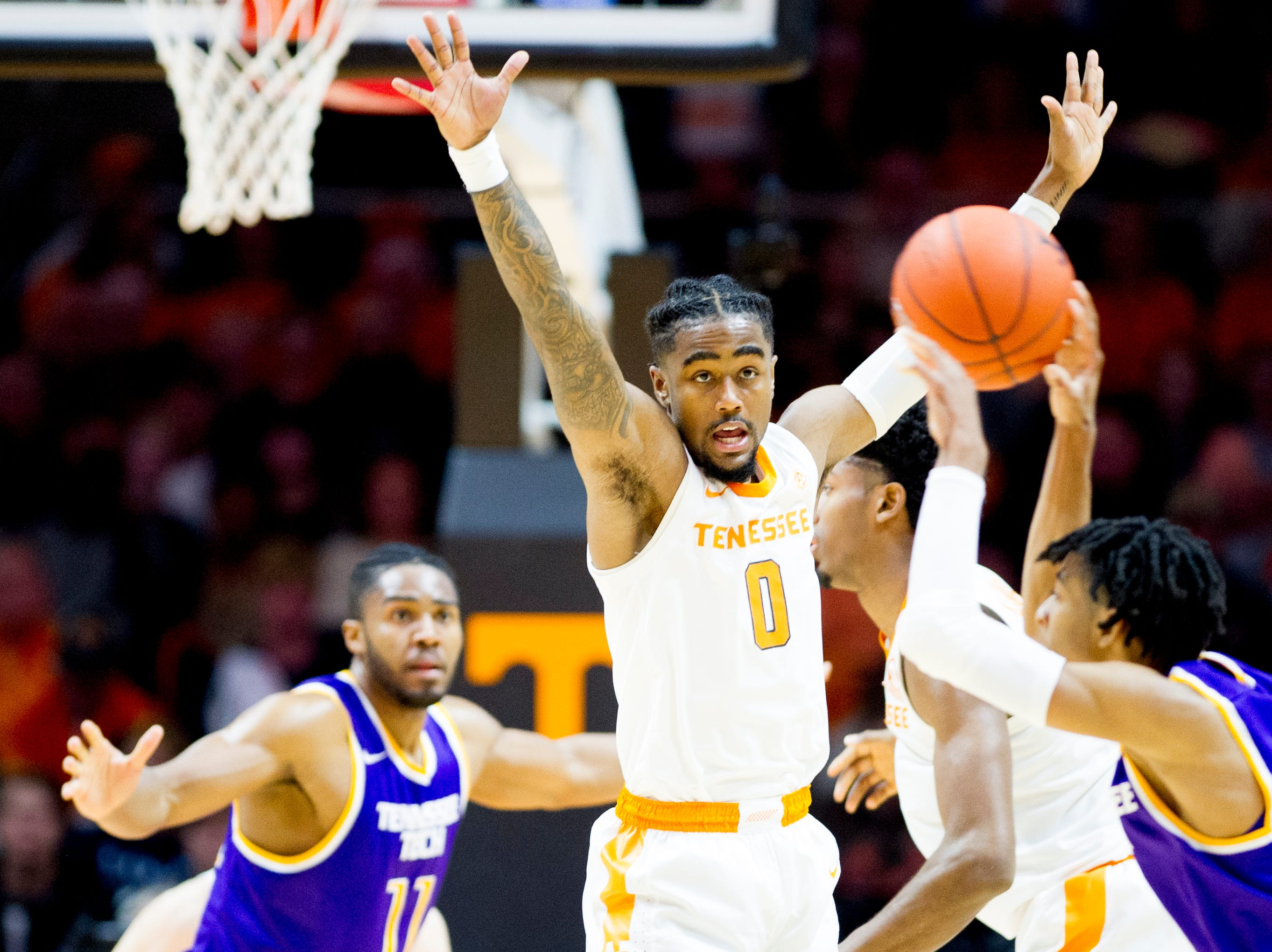 Tennessee guard Jordan Bone (0) defends against a pass by Tennessee Tech guard Jr. Clay (4) during a game between Tennessee and Tennessee Tech at Thompson-Boling Arena in Knoxville, Tennessee on Saturday, December 29, 2018.
