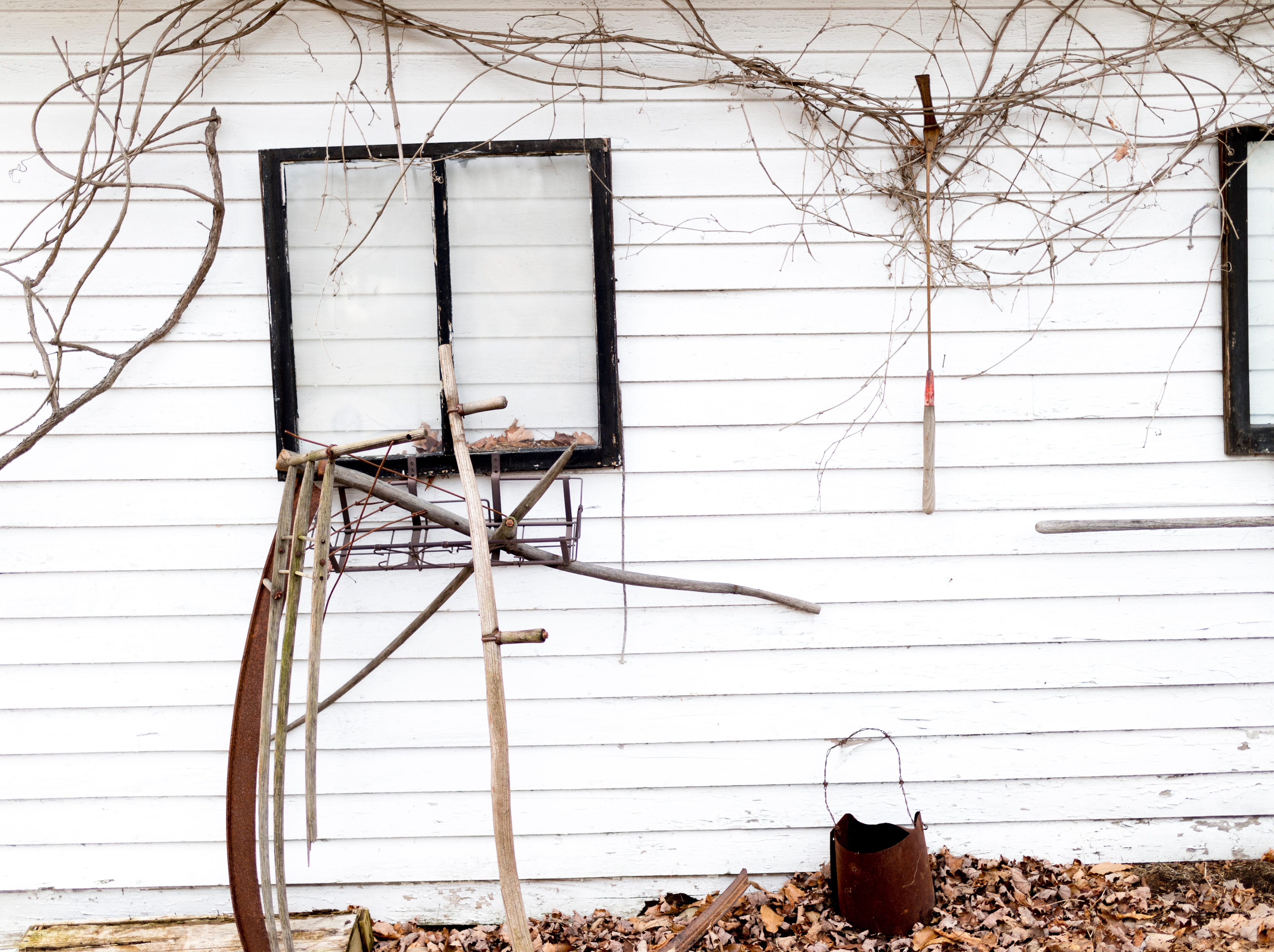 Rustic items decorate the parking lot at The Front Porch Restaurant in Powell, Tennessee on Saturday, December 29, 2018. For five years, owner Bart Elkins has worked to revive that experience of the front porch being used as the focus for family and friends.