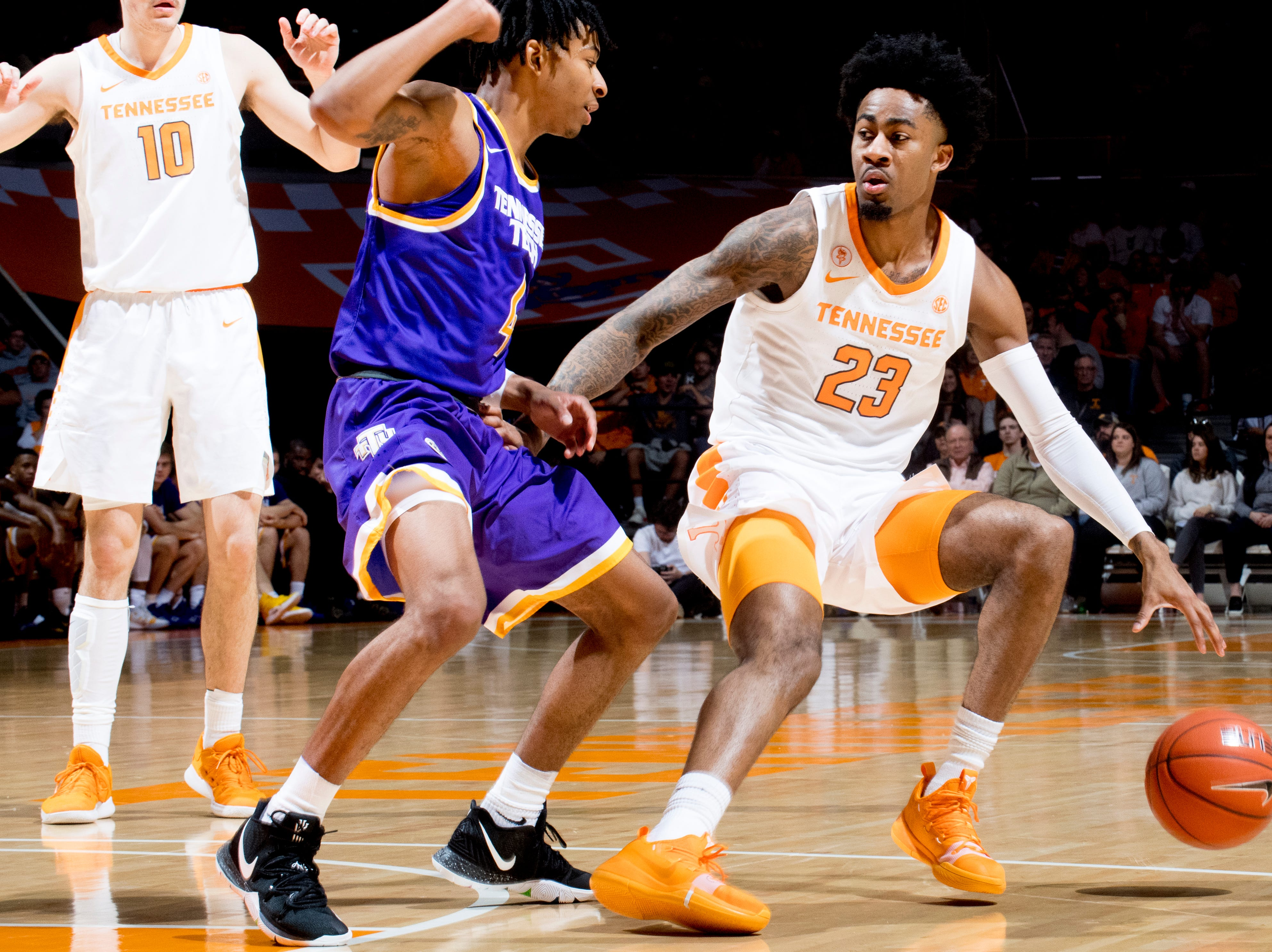 Tennessee guard Jordan Bowden (23) dribbles the ball as Tennessee Tech guard Jr. Clay (4) defends during a game between Tennessee and Tennessee Tech at Thompson-Boling Arena in Knoxville, Tennessee on Saturday, December 29, 2018.