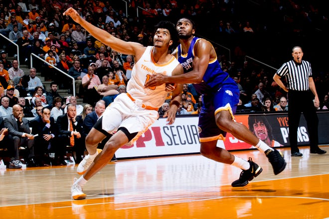 Tennessee forward Derrick Walker (15) and Tennessee Tech center Micaiah Henry (11) eye the ball during a game  Dec. 29.