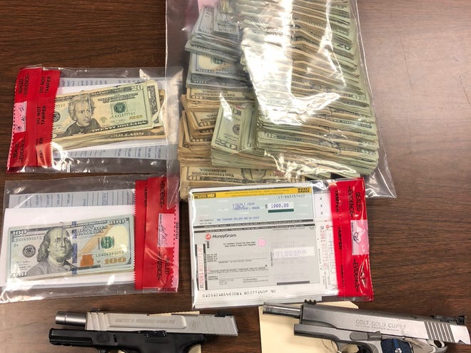 "More than $65,000 worth of drugs — more than 5 pounds of marijuana and 200 chocolate cannabis bars — drug paraphernalia, two hand guns, two vehicles and more than $26,000 in cash were found in a multi-jurisdictional raid of a ""stash house"" in Duson, according to police."