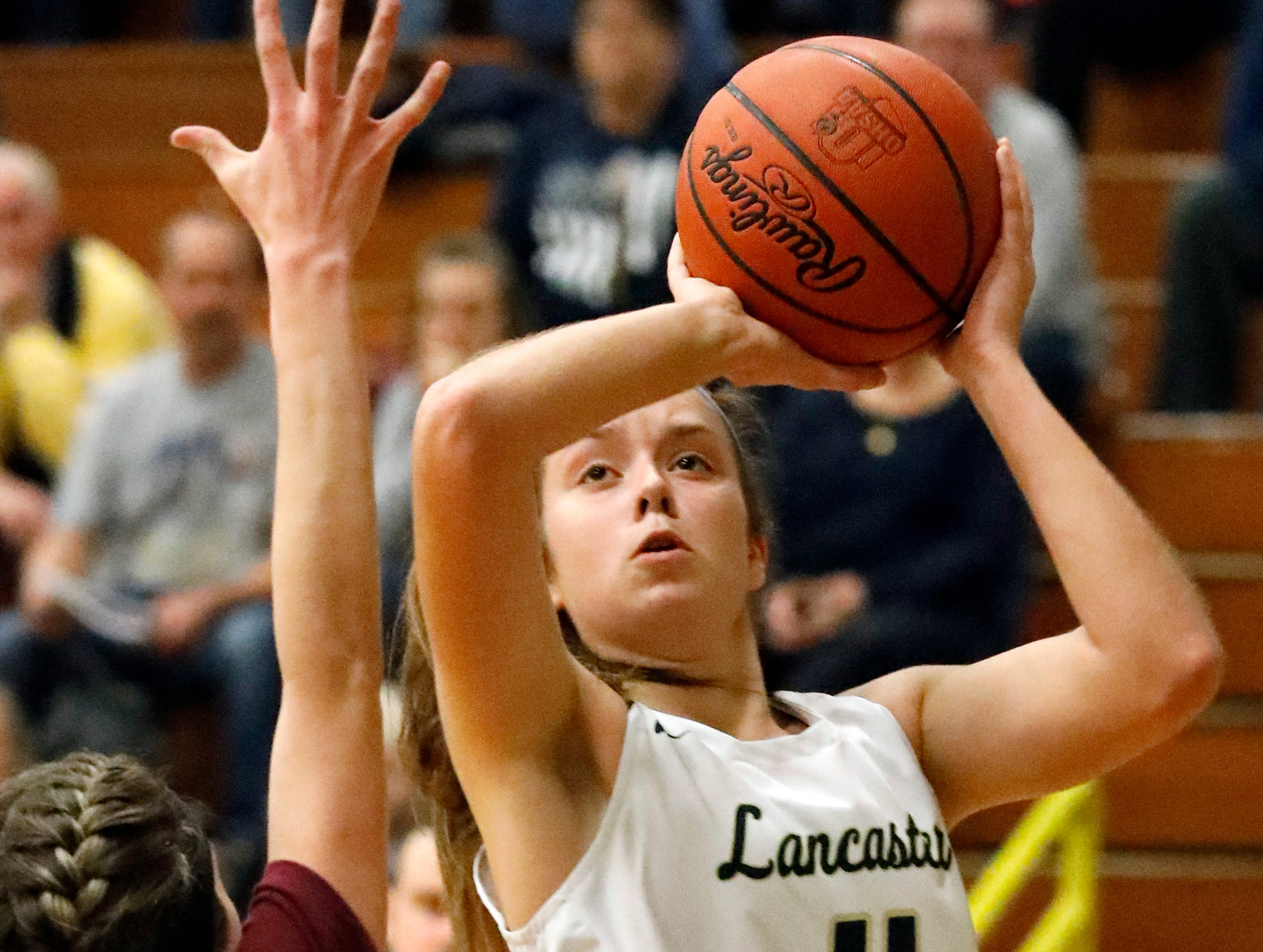 Lancaster's Brittney Azbell prepares to shoot the ball during Friday night's game, Dec. 28, 2018, at Lancaster High School in Lancaster. The Golden Gales won the game over Licking Heights 43-37.
