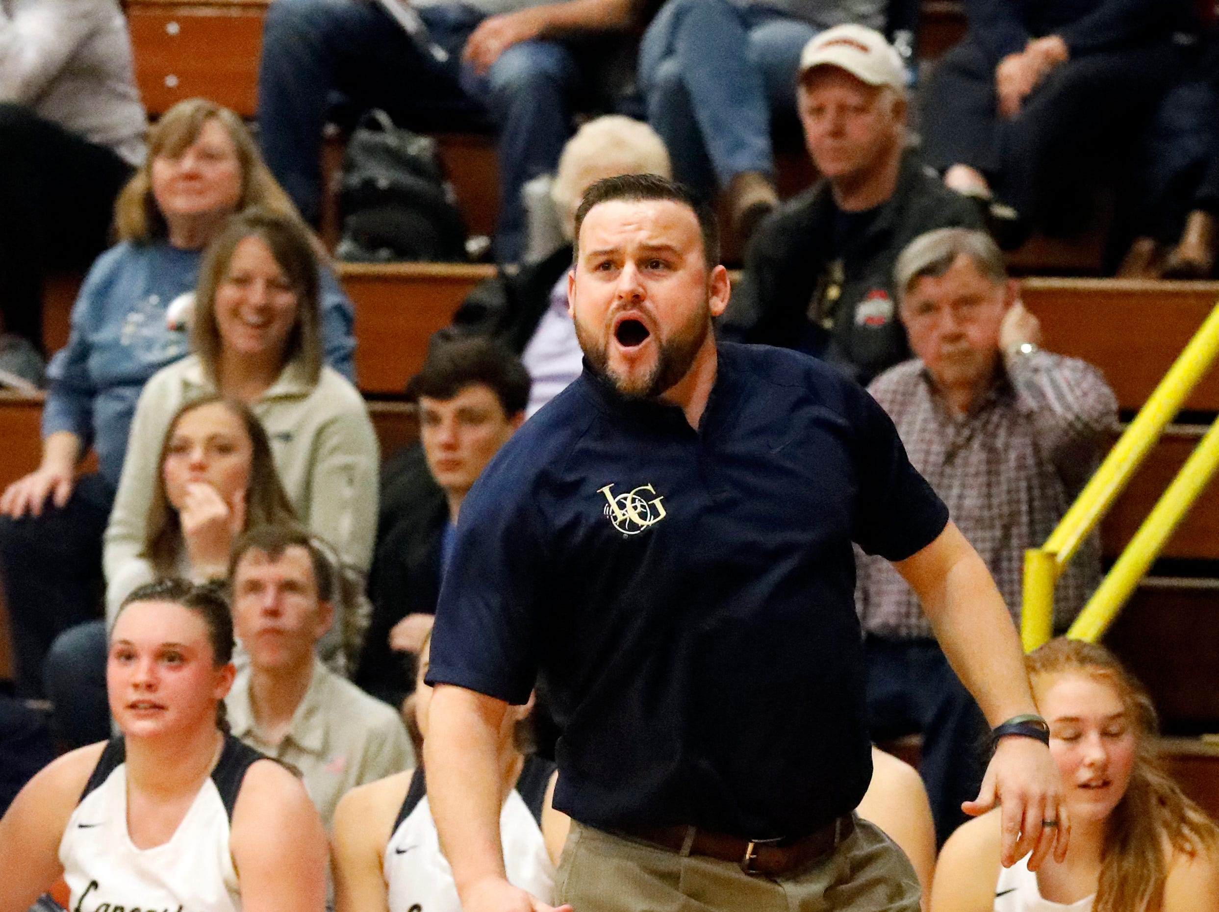 Lancaster coach Dusty Miller yells instructions to his players Friday night, Dec. 28, 2018, during the Golden Gales 43-37 win over Licking Heights.