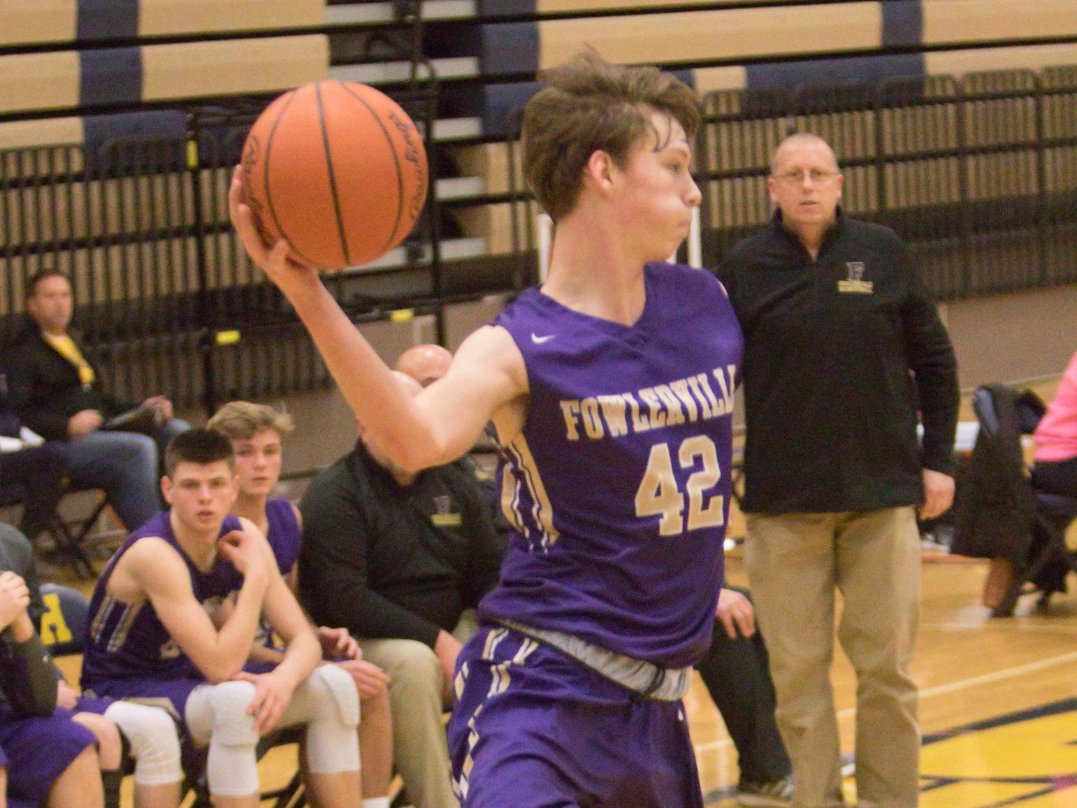 Fowlerville's Billy Hutchins passes in the fourth quarter of the tournament game against the Dreadnaughts Friday, Dec. 28, 2018.