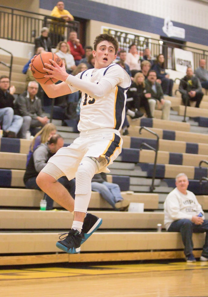 Hartland Eagle Collin Arnold keeps the ball in play in the tournament game against the South Lyon East Cougars Friday, Dec. 28, 2018.