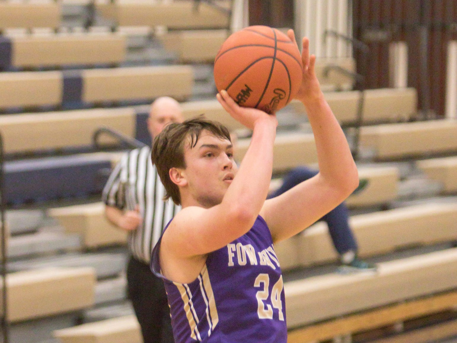 Fowlerville's Brendan Young shoots in the tournament game against Dexter Friday, Dec. 28, 2018.
